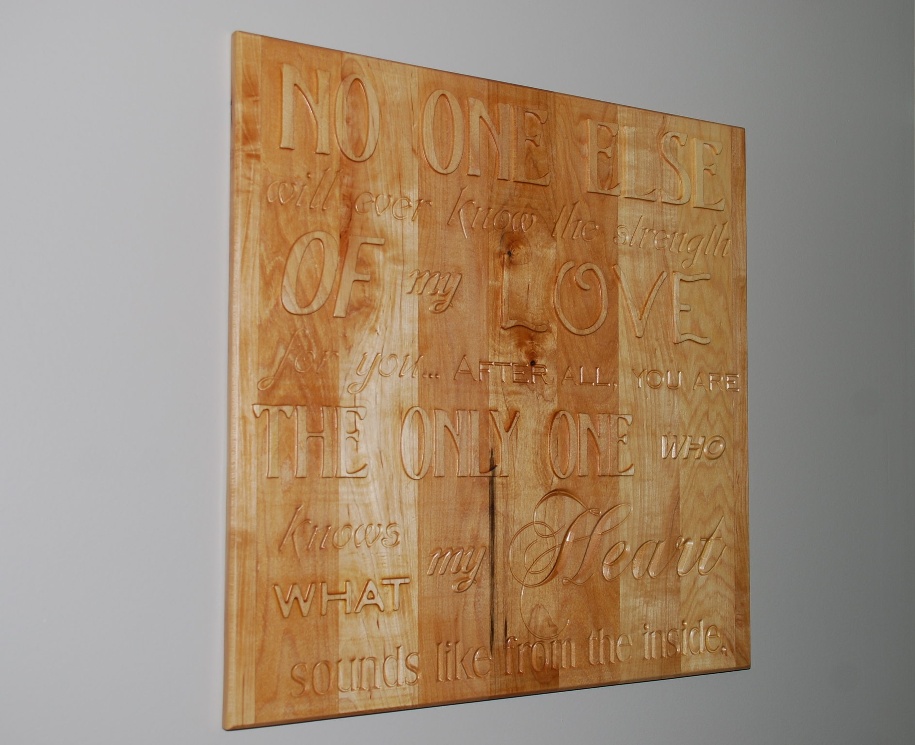 This sign was created out of a laminated slab of maple. It uses a combination of Pocketing and V-carving to create the desired effect. The lettering was intentionally left unpainted to help showcase the natural beauty of the wood.