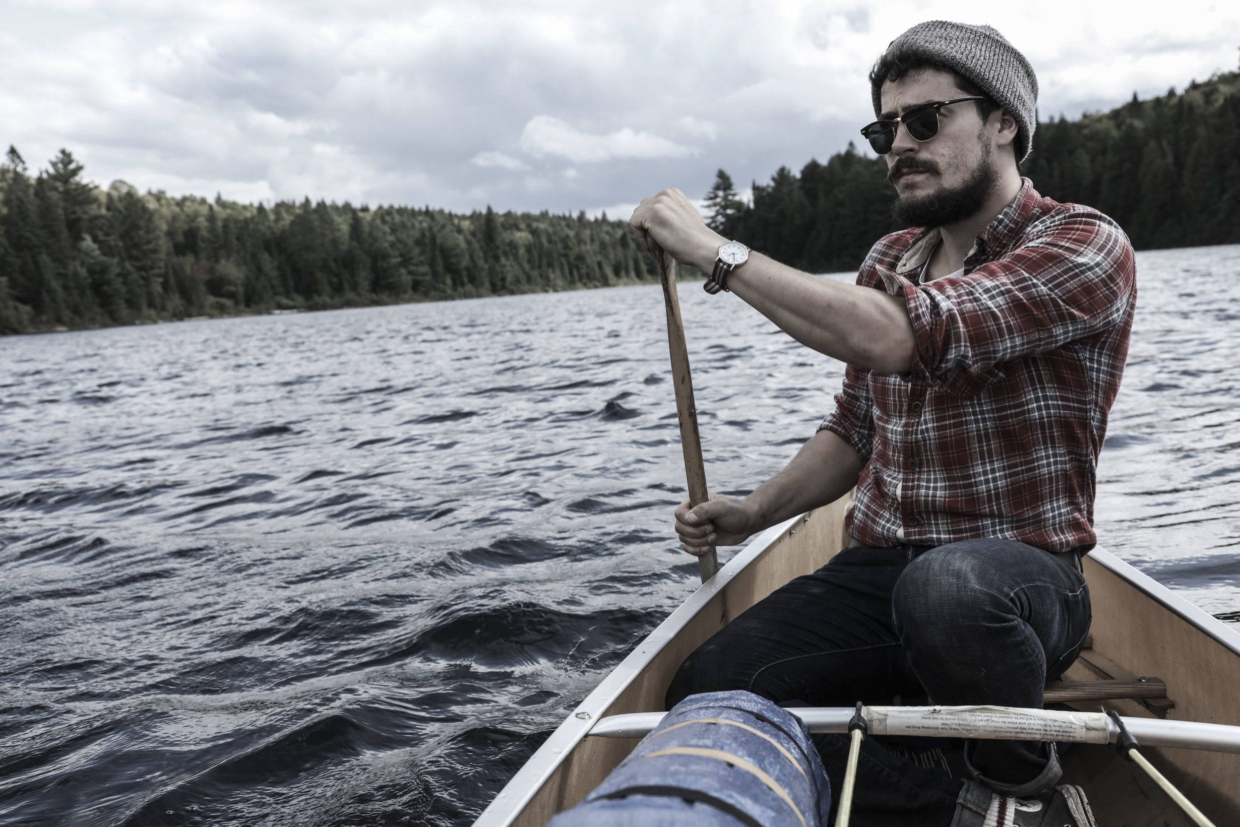 Cal Irvine paddle steers a canoe in White Birch Lake in Algonquin Provincial Park, ON, September 2016. (Megan Perra)