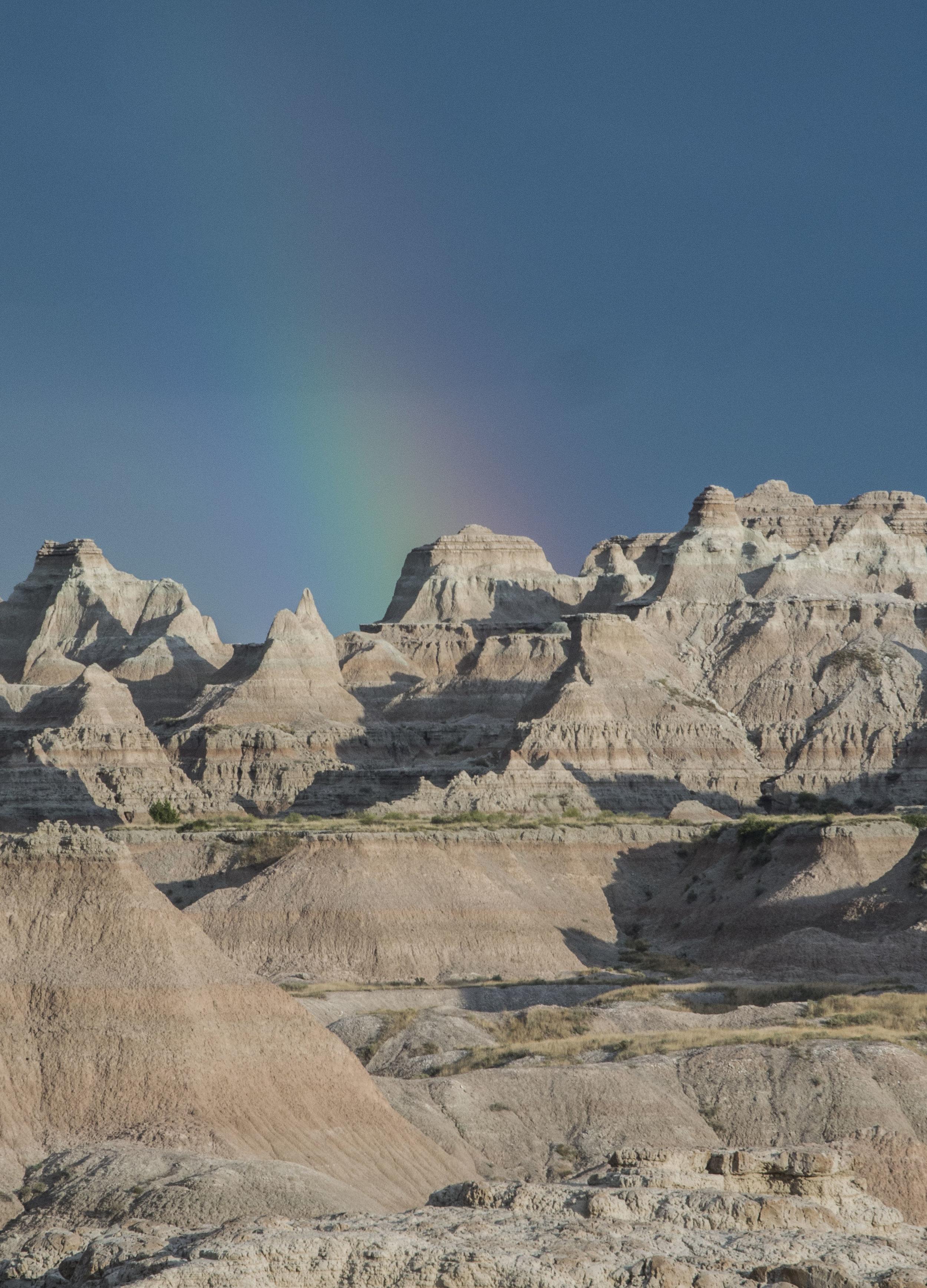 A rainbow precedes an evening thunderstorm in Badlands National Park, South Dakota in August 2016. (Megan Perra)