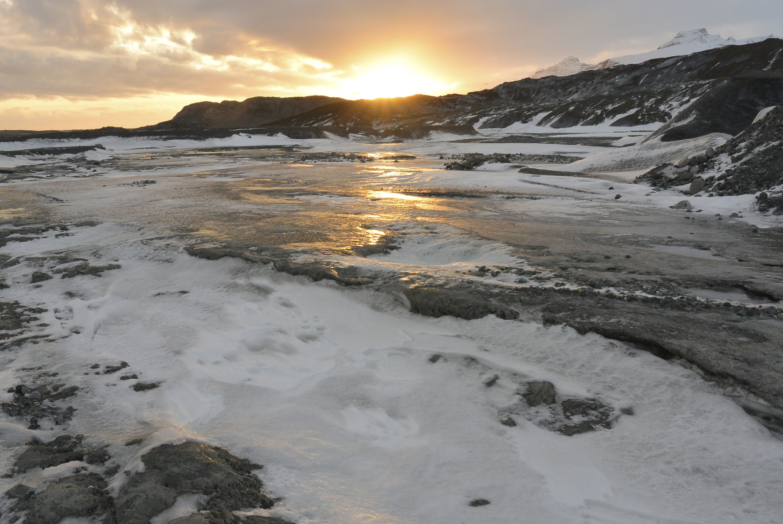The afternoon sunset glints off the ice near Vatnajökull's ice caves in SE Iceland in January, 2016. (Megan Perra)