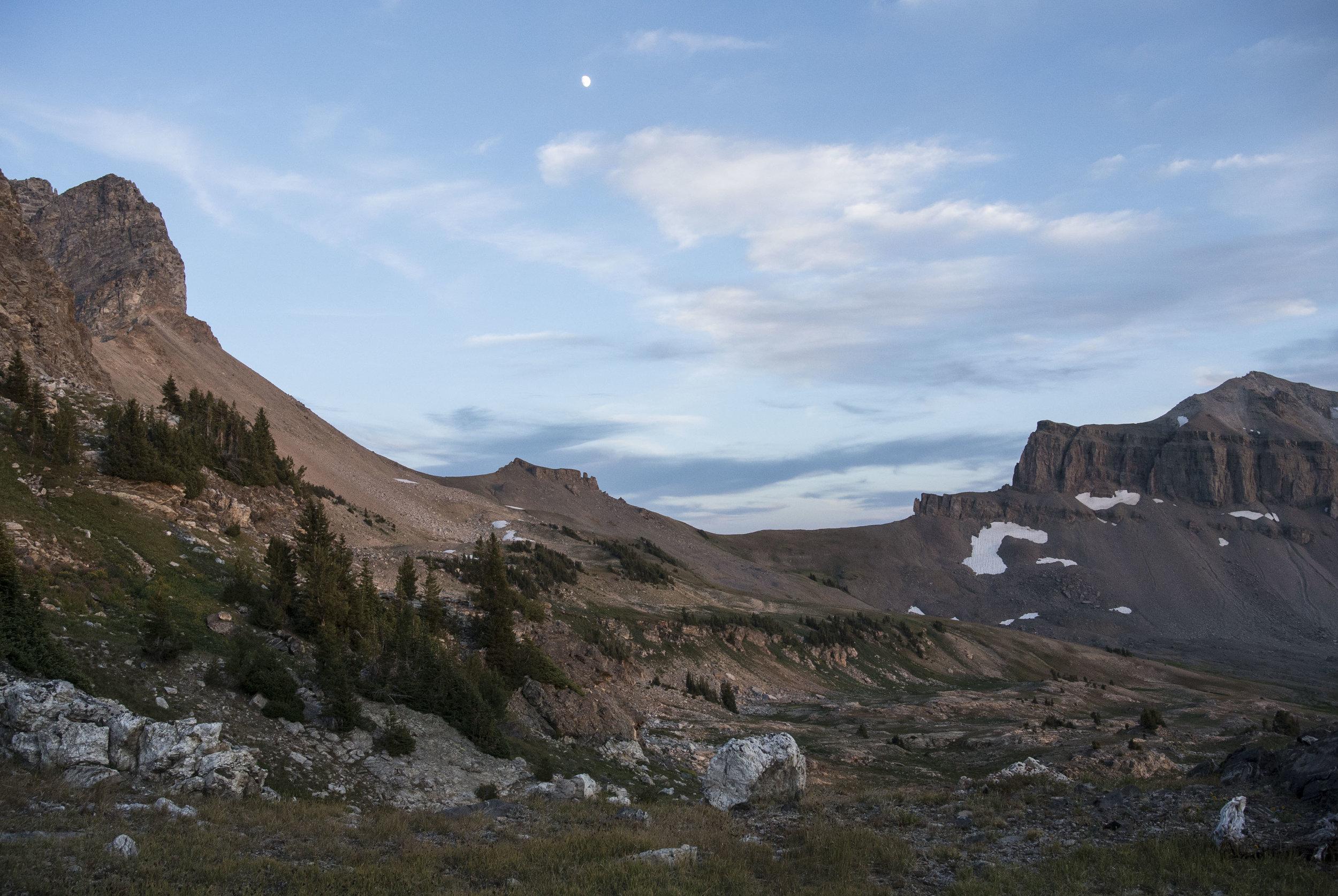 The moon rises beside Buck Peak in the Caribou-Targhee National forest, overlooking the Alaska Basin in Wyoming, in August 2016. (Megan Perra)