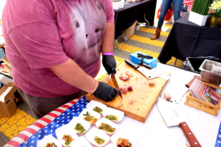 Hoodoo Brown BBQ, one of the top barbecue joints in Connecticut, prepares crispy pork belly at 2017's Pig Island event.