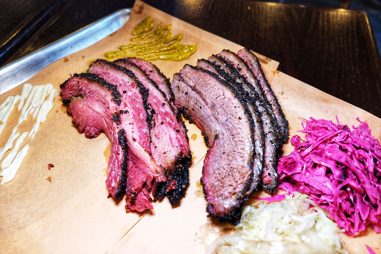If you make it to Izzy's Smokehouse in Brooklyn, make sure to try the brisket and pastrami.