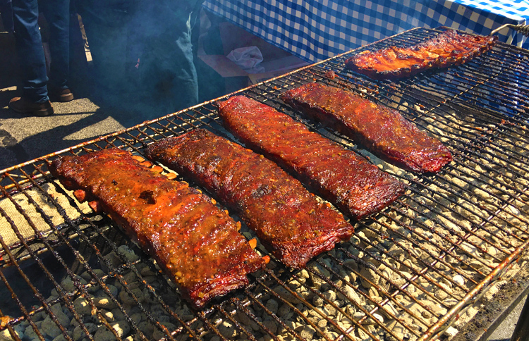 Dinosaur Bar-B-Que's famous ribs being prepared at the Big Apple Barbecue Block Party.