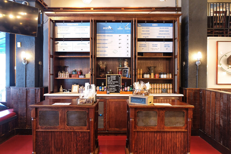 Customers pick up their food during Blue Smoke's new counter-service lunch.