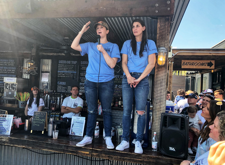 Jeff Michner's sister Meghan (left) and wife Sara both spoke to the crowd during the event.    Watch the video here to see the full moment   .