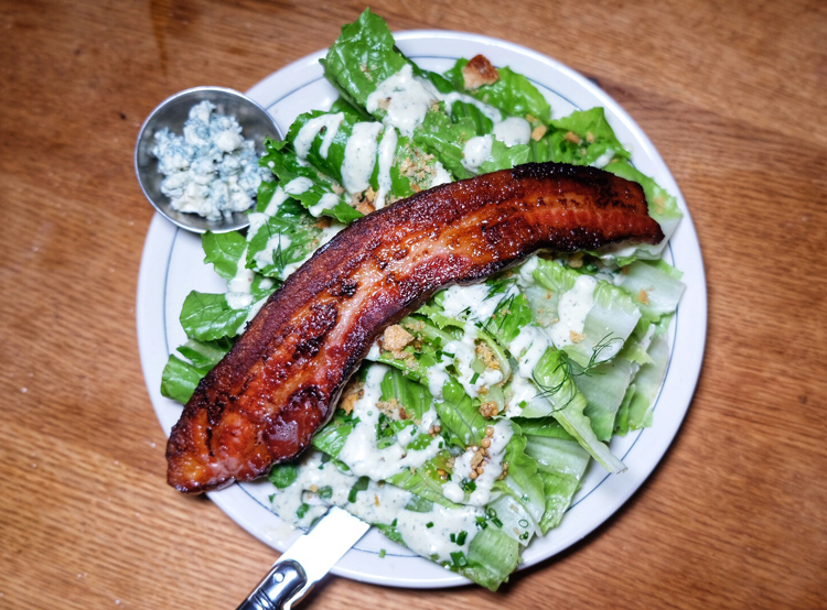 The romaine wedge salad with thick-cut applewood-smoked bacon and blue cheese is extremely tasty.