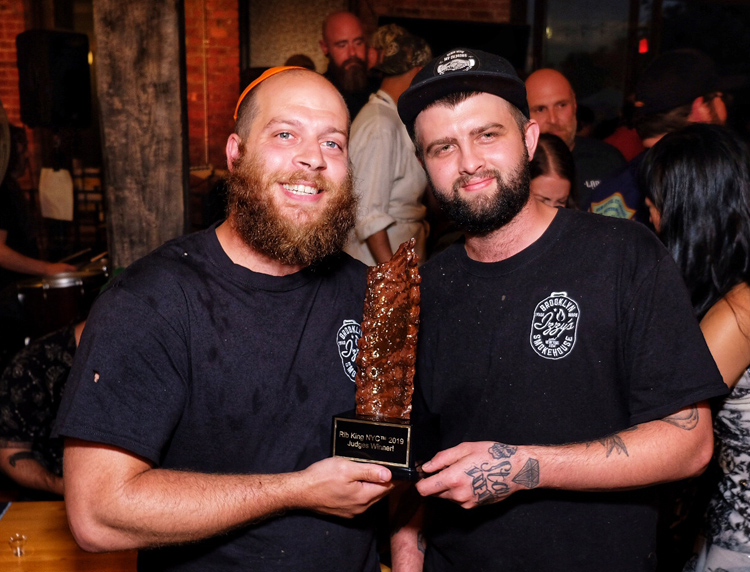 Izzy Eidelman poses with his Rib King 2019 trophy. He previously won Brisket King 2017 as well.