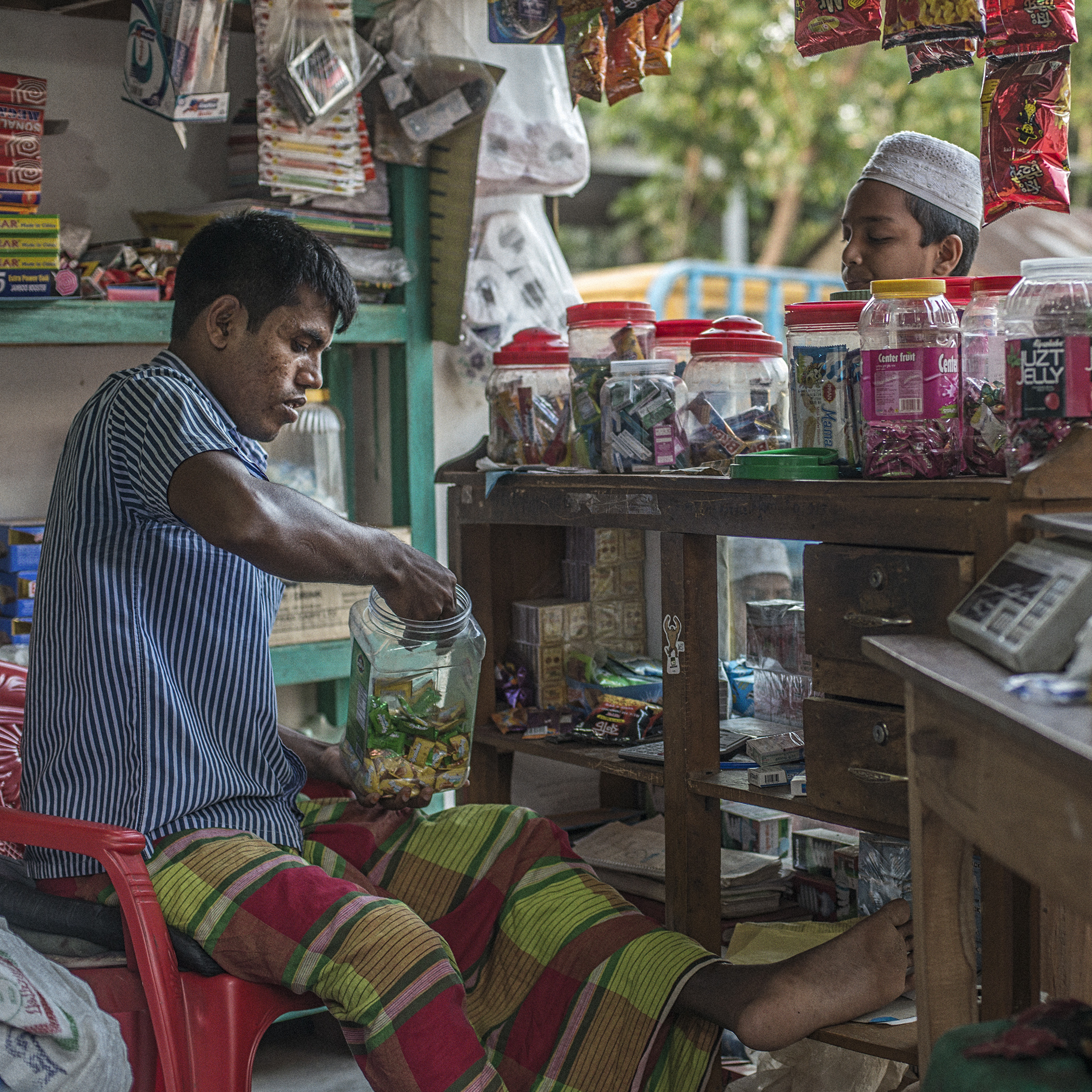 Sujon Mia, proud shop owner, continues to fight the memory of the Rana Plaza collapse and his disability due to it, by empowering himself with his job as a small-time business owner