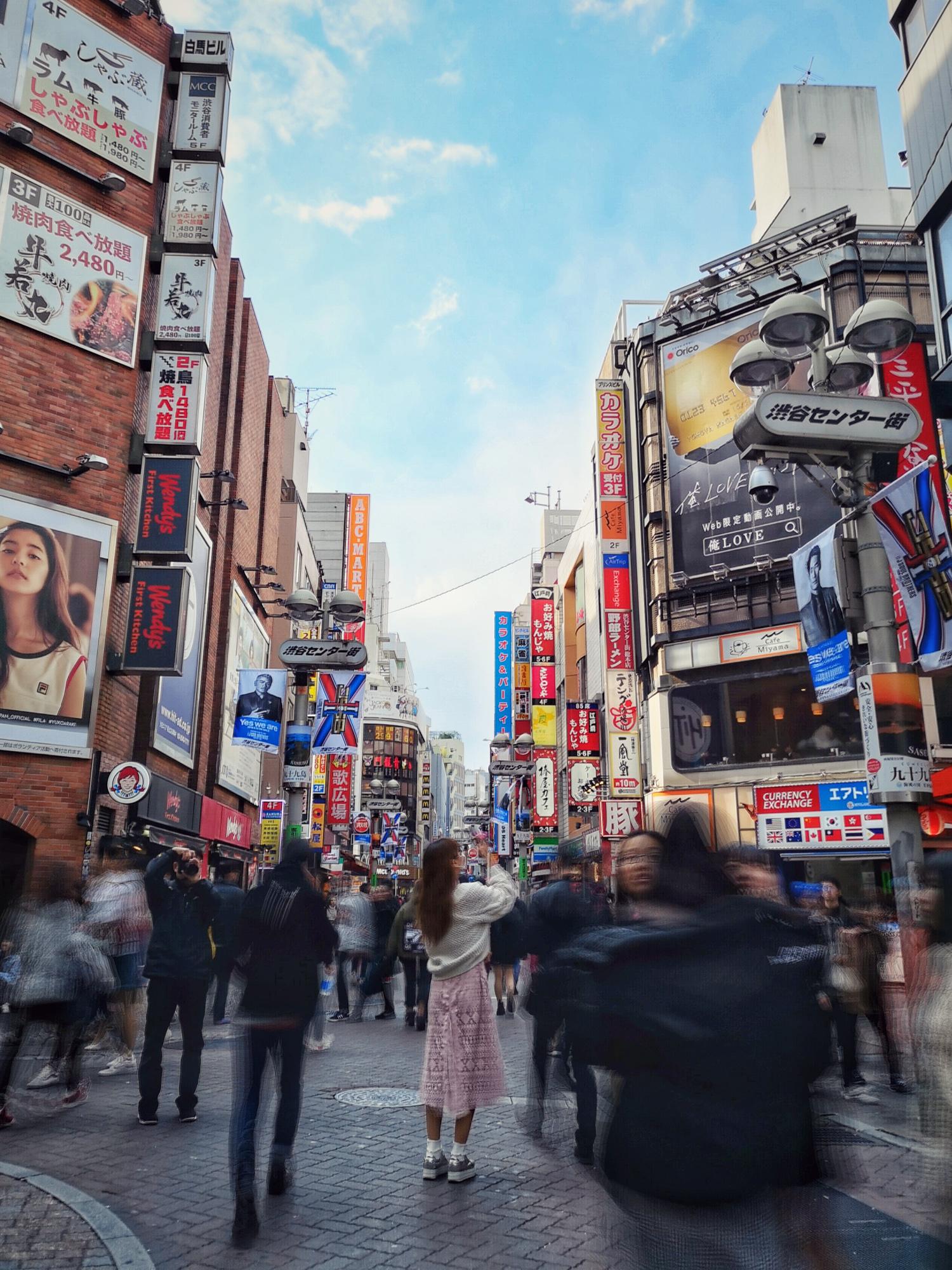 Woman taking a photo in Shibuya, Tokyo. Huawei P20 Pro Light Painting