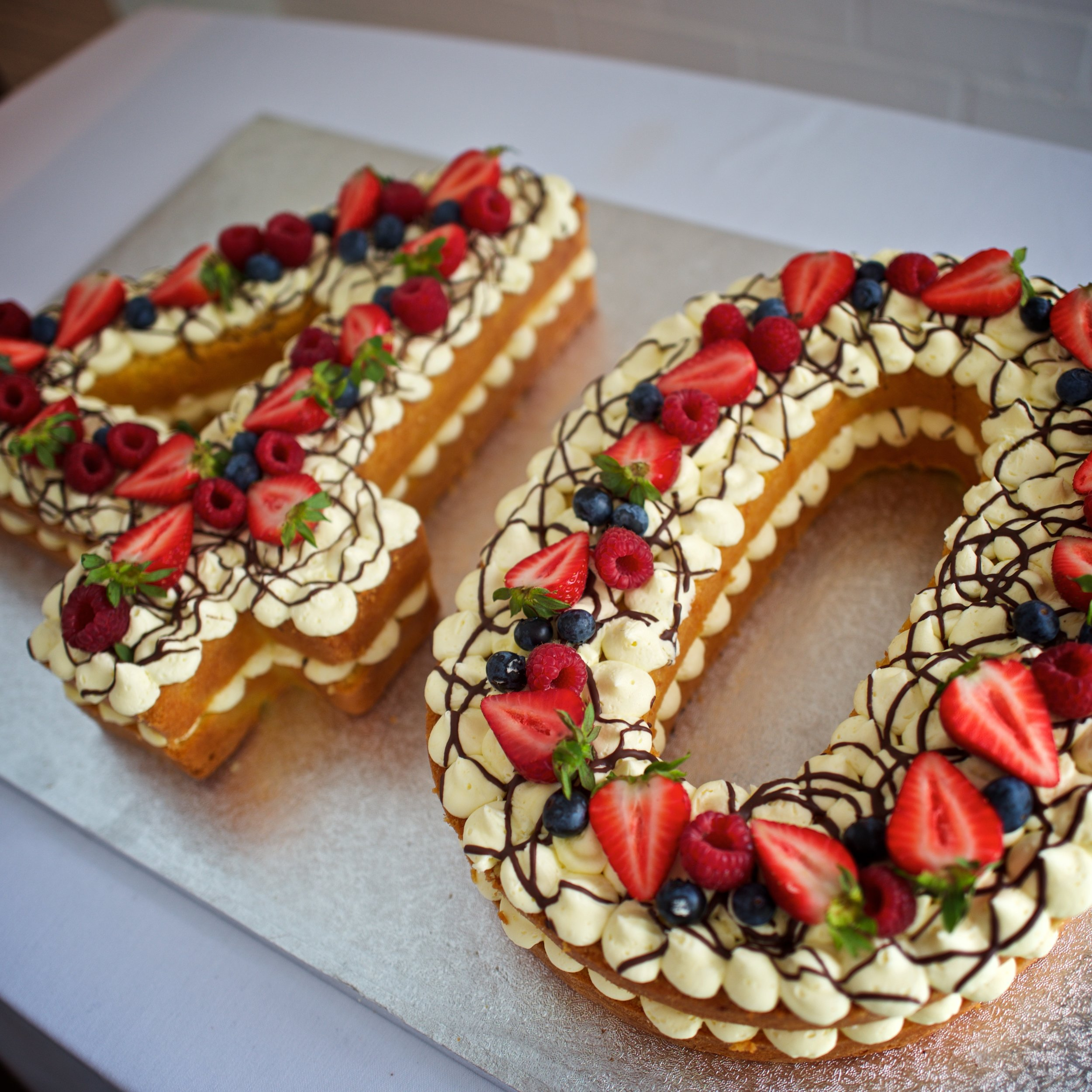 Vanilla Number Cake    From £80.00