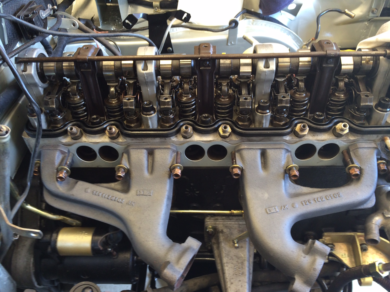 exhaust manifolds back on , rocker cover next..