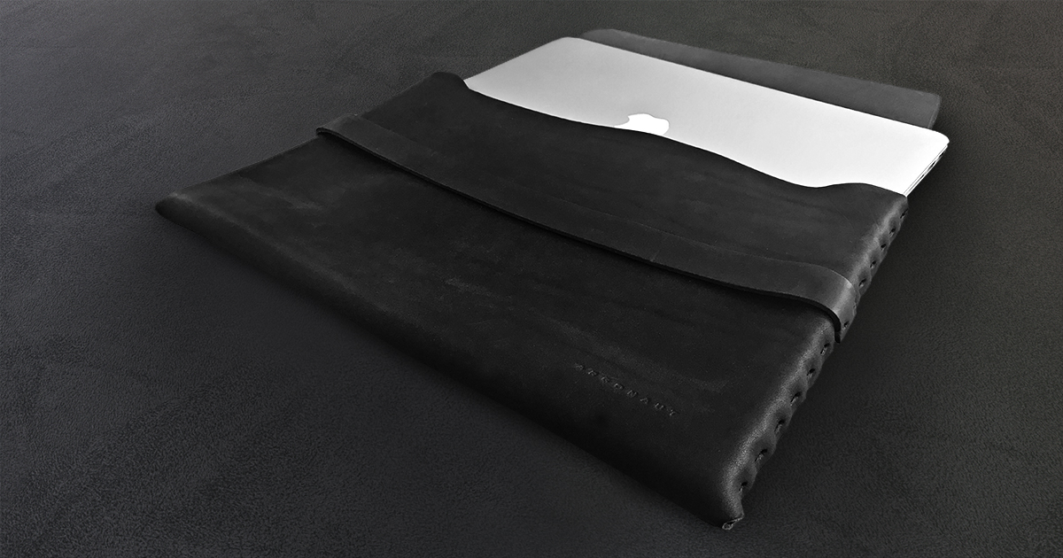Custom Billy Kirk black leather laptop cases.