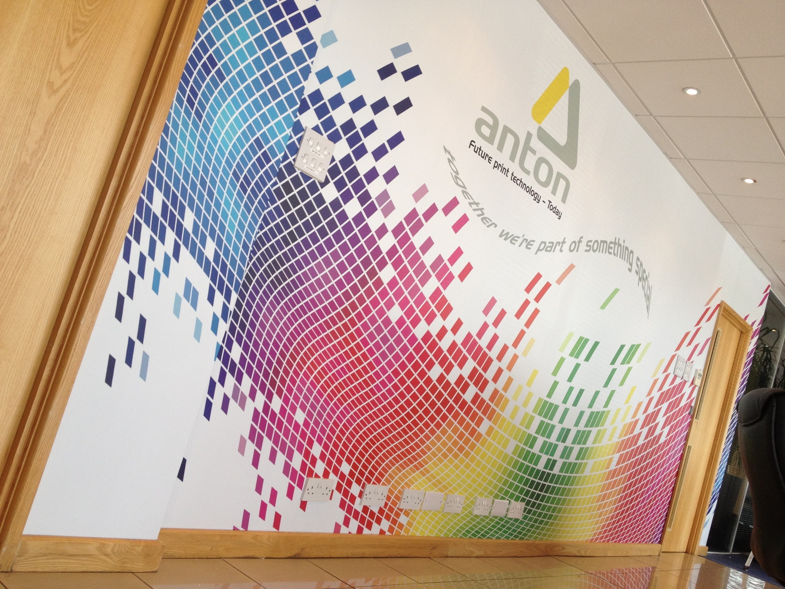 An office reception wall wrap installation