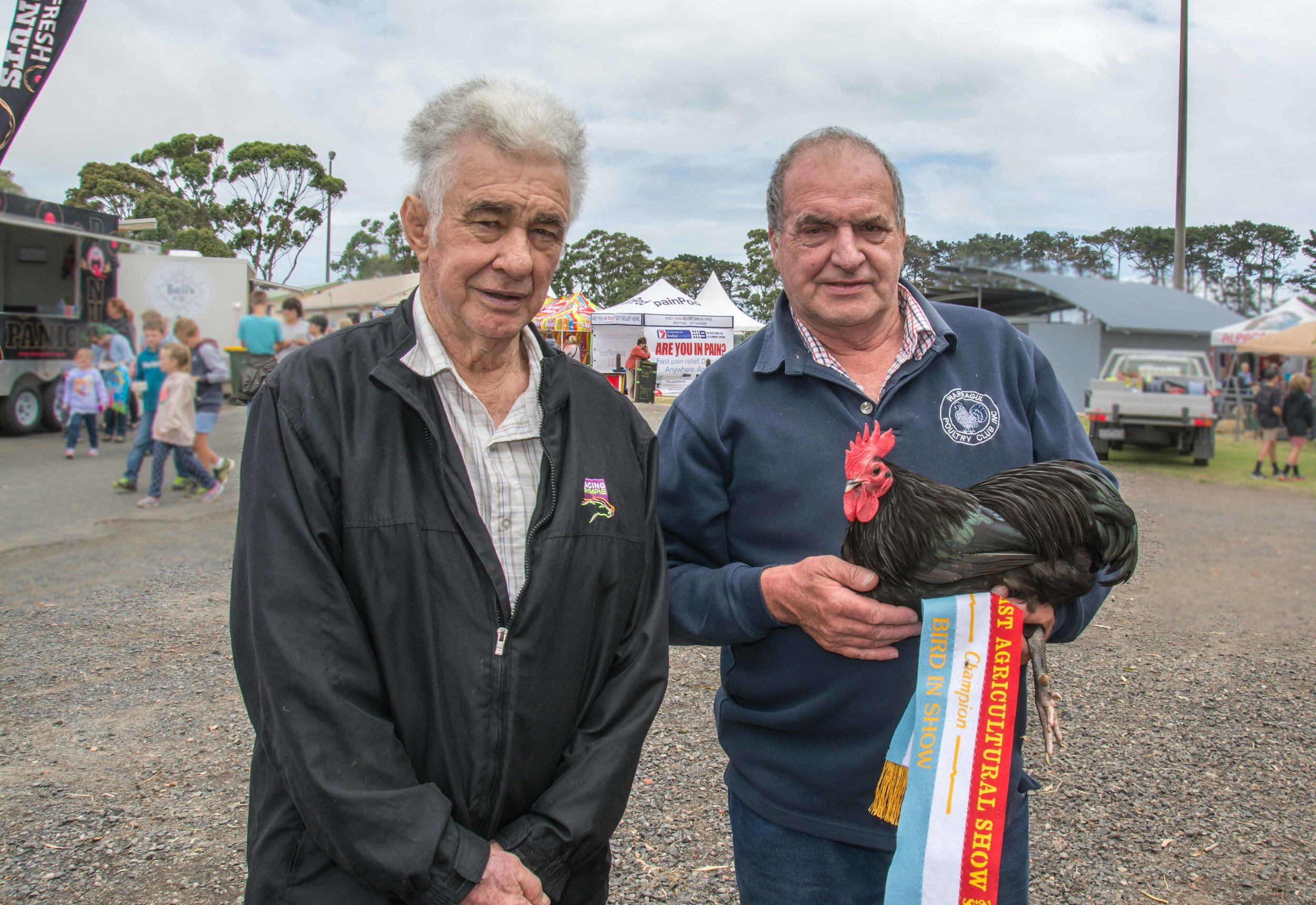 Judge Noel Nelson and winner of Best Bird in Show, Kevin Collins