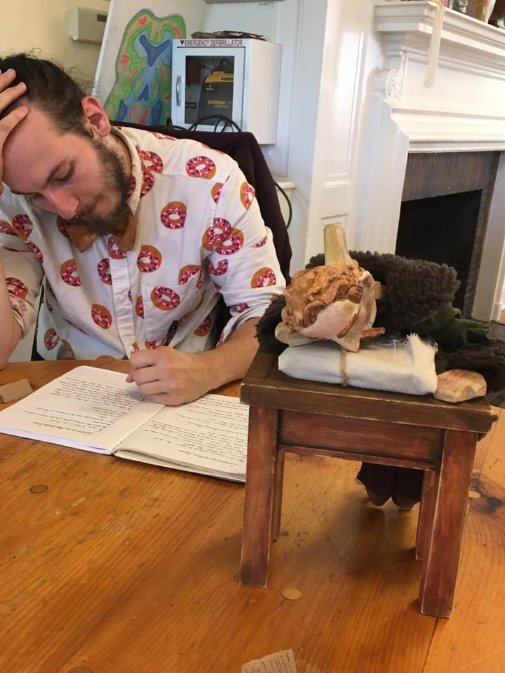 Taking notes and writing sketches for puppets/puppet shows at New England Puppetry Intensive, 2016.