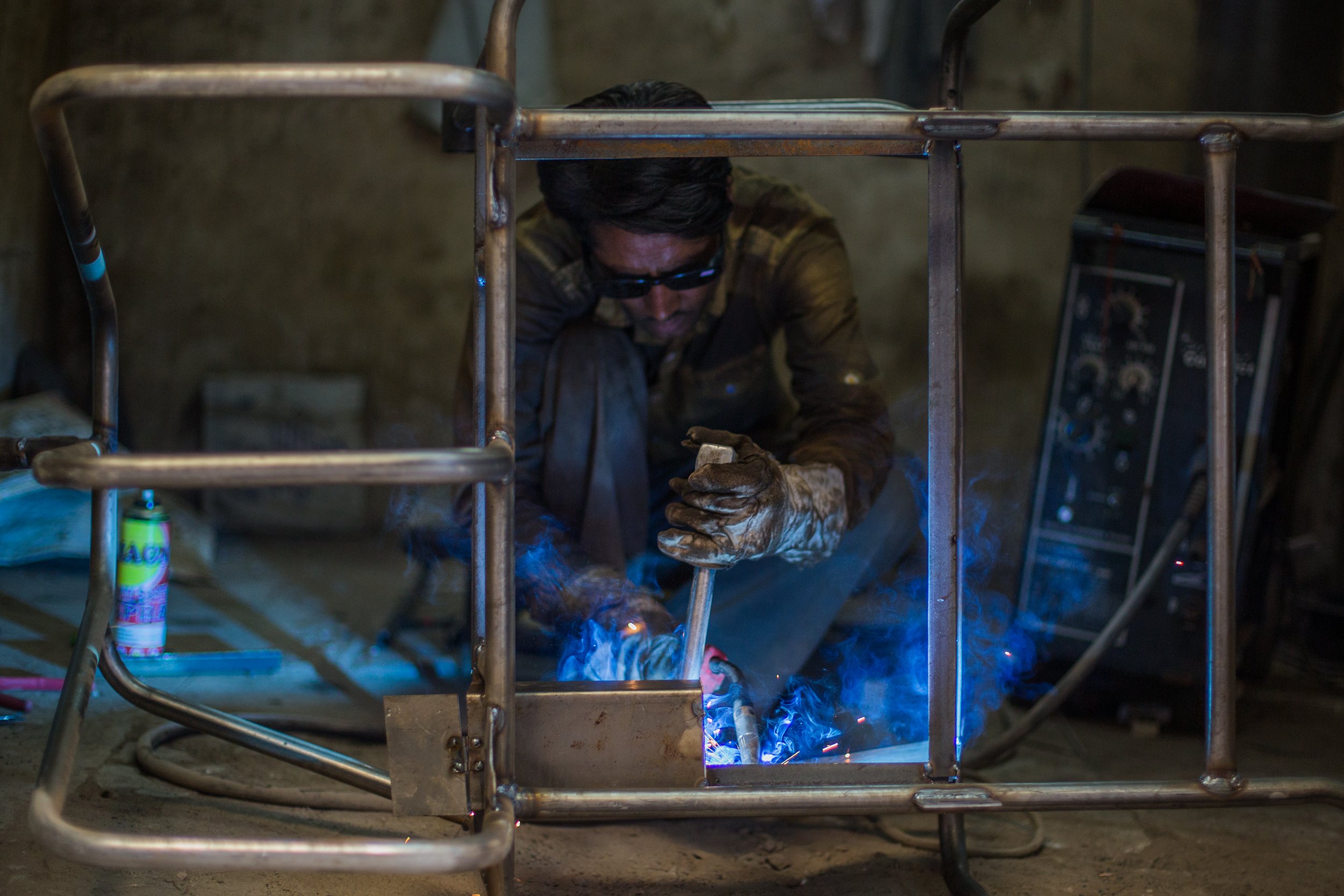 Welding a hand-pedaled tricycle frame for patients who have lost both their feet or mobility of their lower limbs. The tricycles are provided free of charge and enable patients to independently move around and increase their autonomy.