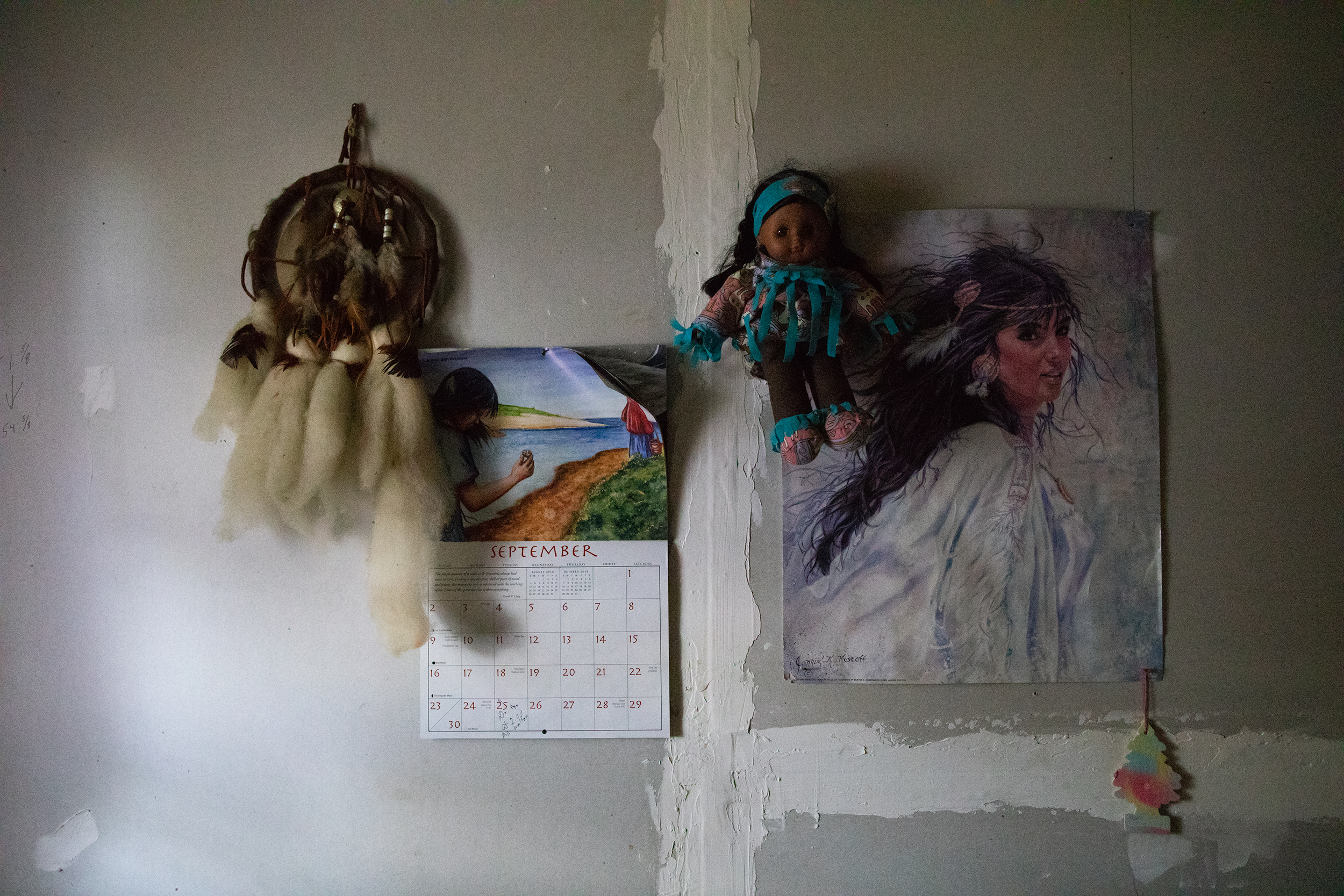 Dreamcatchers and Native American images cover Brenda's bedroom wall. They are reminders of her biological mother who was part Cherokee.