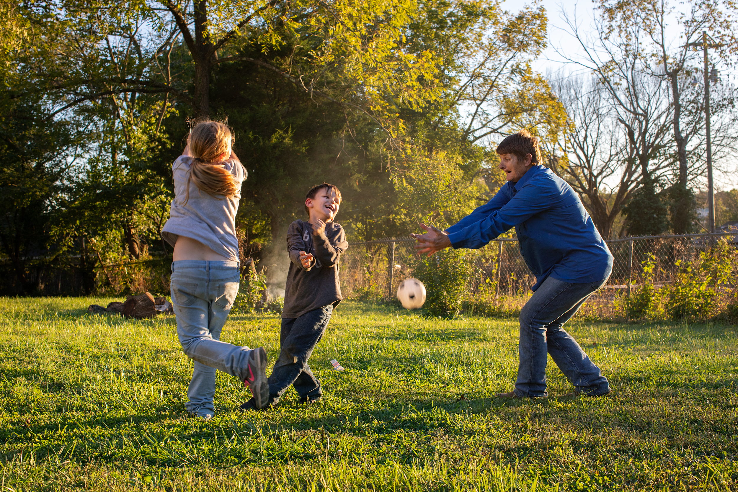 Brenda plays with her grandson, Jonathan, and her grandniece, Grace, in their yard in Mountain Grove, Mo.