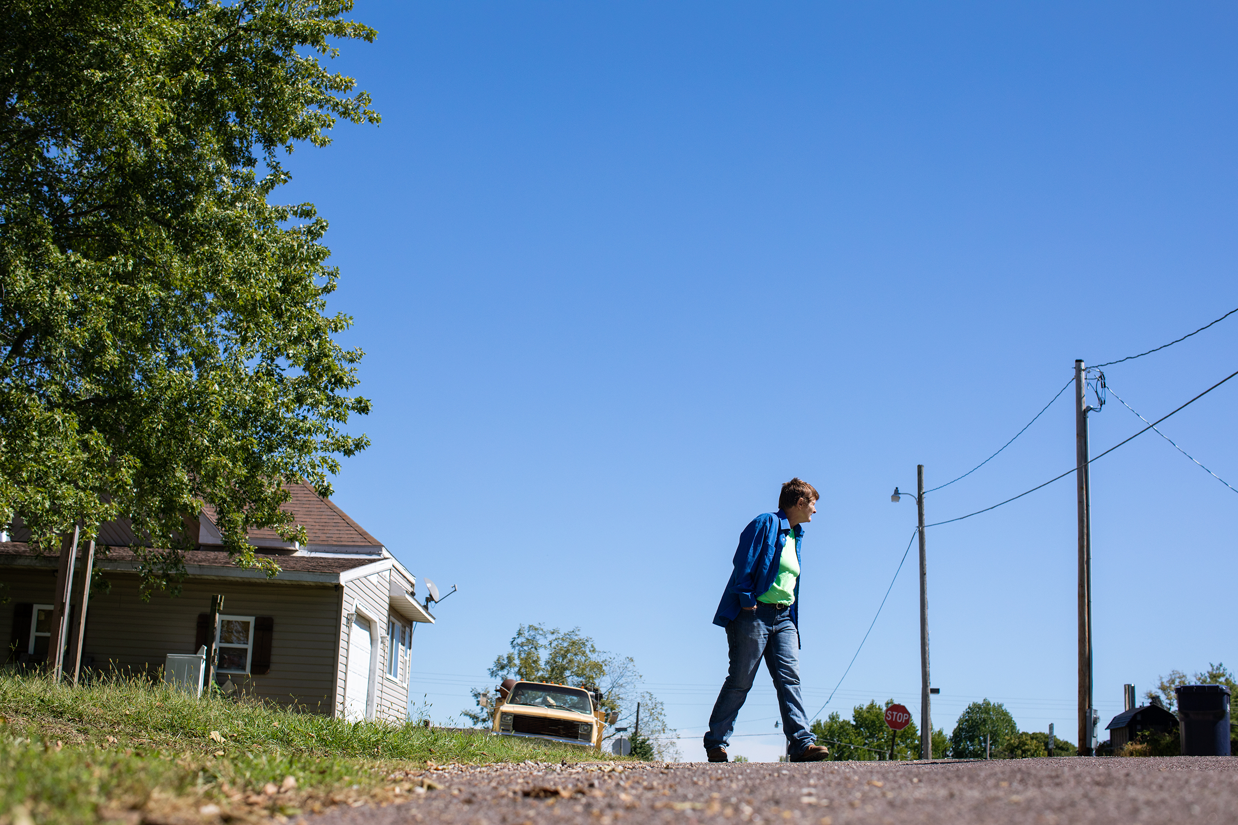 Brenda walks around her neighborhood in Mountain Grove, Mo. Although her difficult past and financial challenges keep her on the edge, she's determined to keep on going, looking for ways to survive.