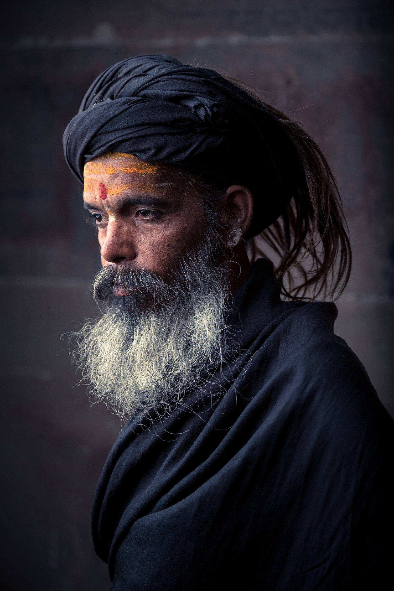We used a so-called 'Short Lighting' light setup here because it works great with character faces like this sadhu's.