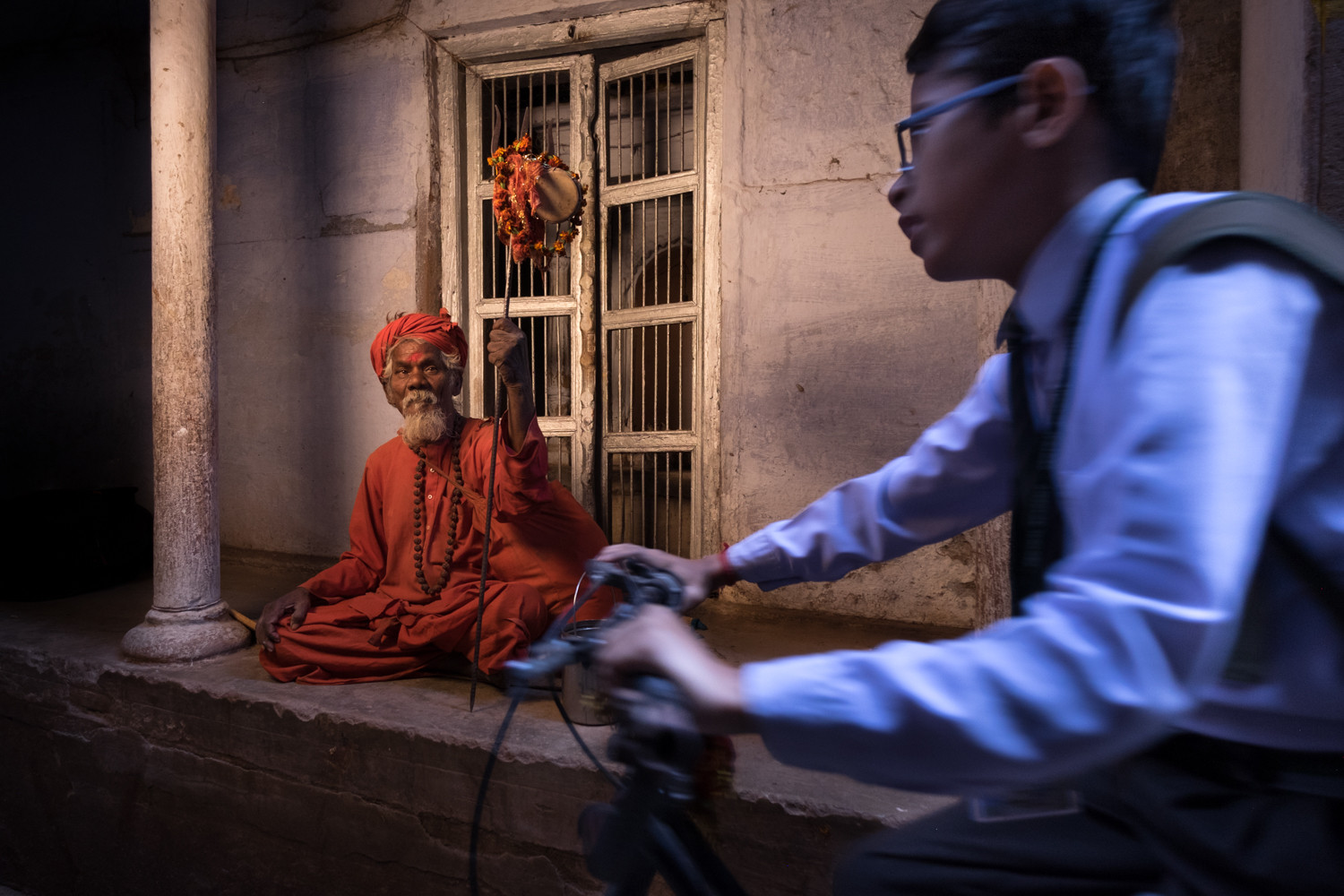 Young meets old in the narrow alleyways of Varanasi. An orange-gelled Cactus RF60 was fired through a gridded SMDV70 Speedbox to produce this image.