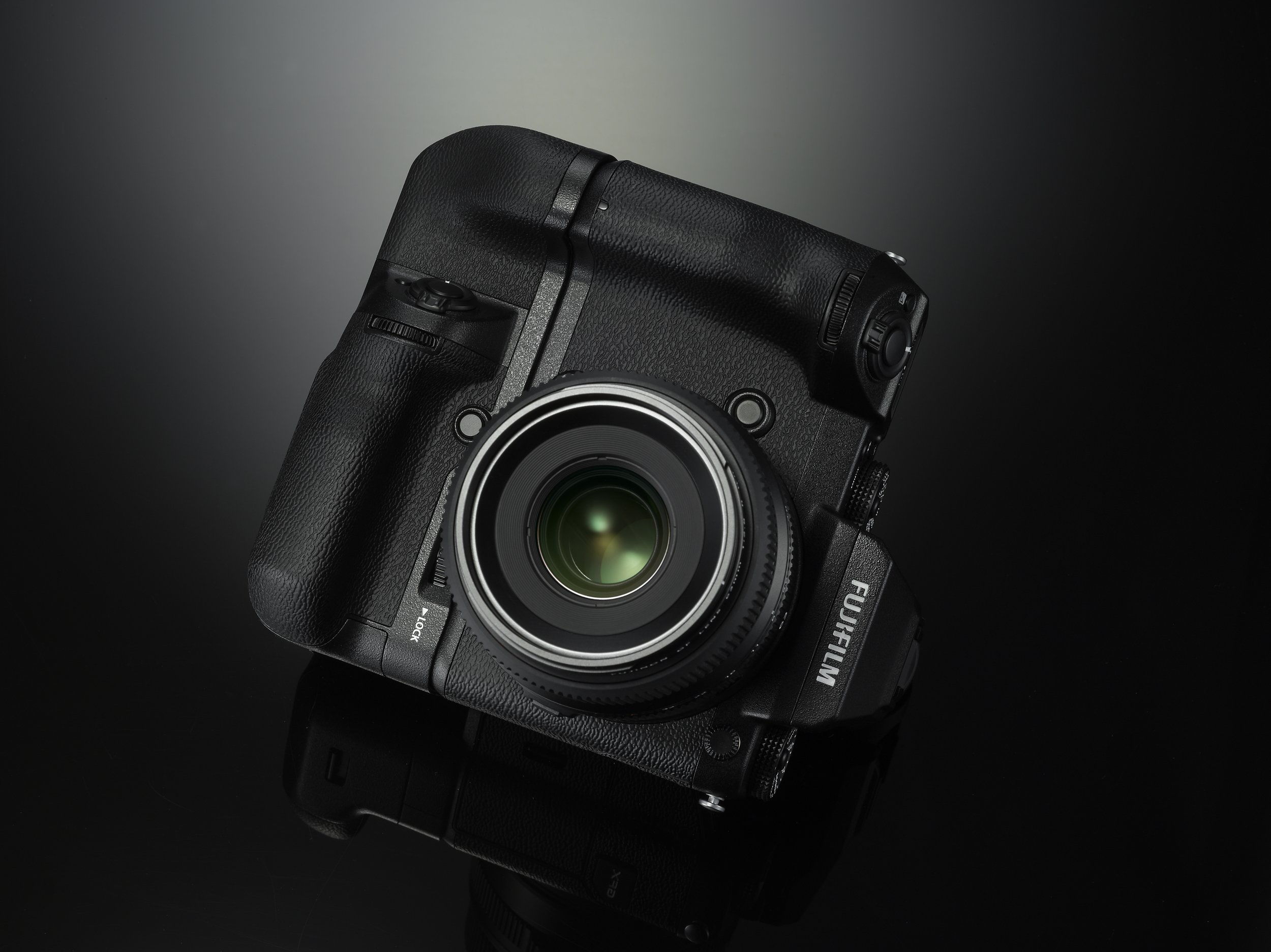 The optional grip turns the GFX into a squarish block. This improves the ergonomics when holding the camera vertically.
