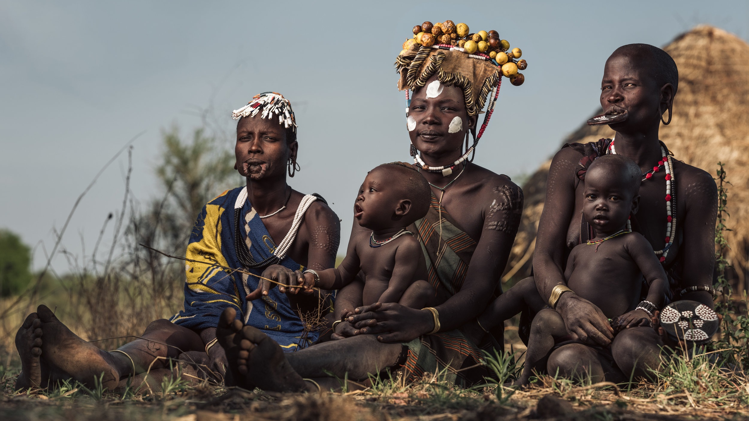 Three women from the Mursi tribe