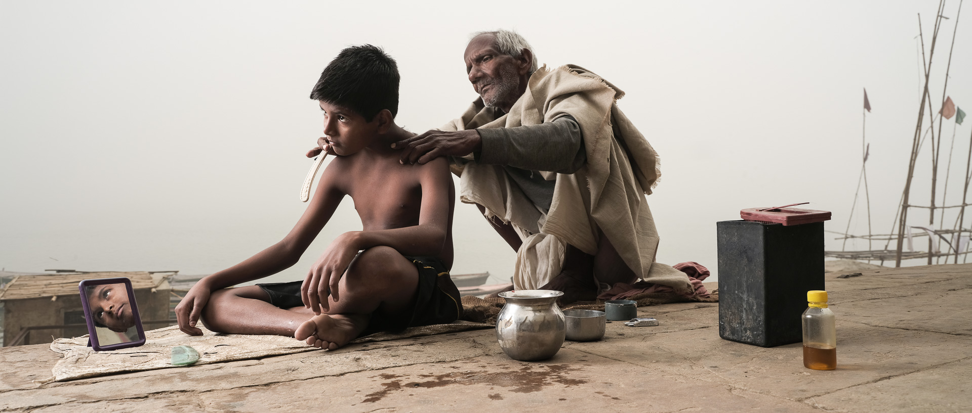 Boy having his hair cut along the shore of the Ganges, Varanasi. Shot during my GFX Challenge video production.