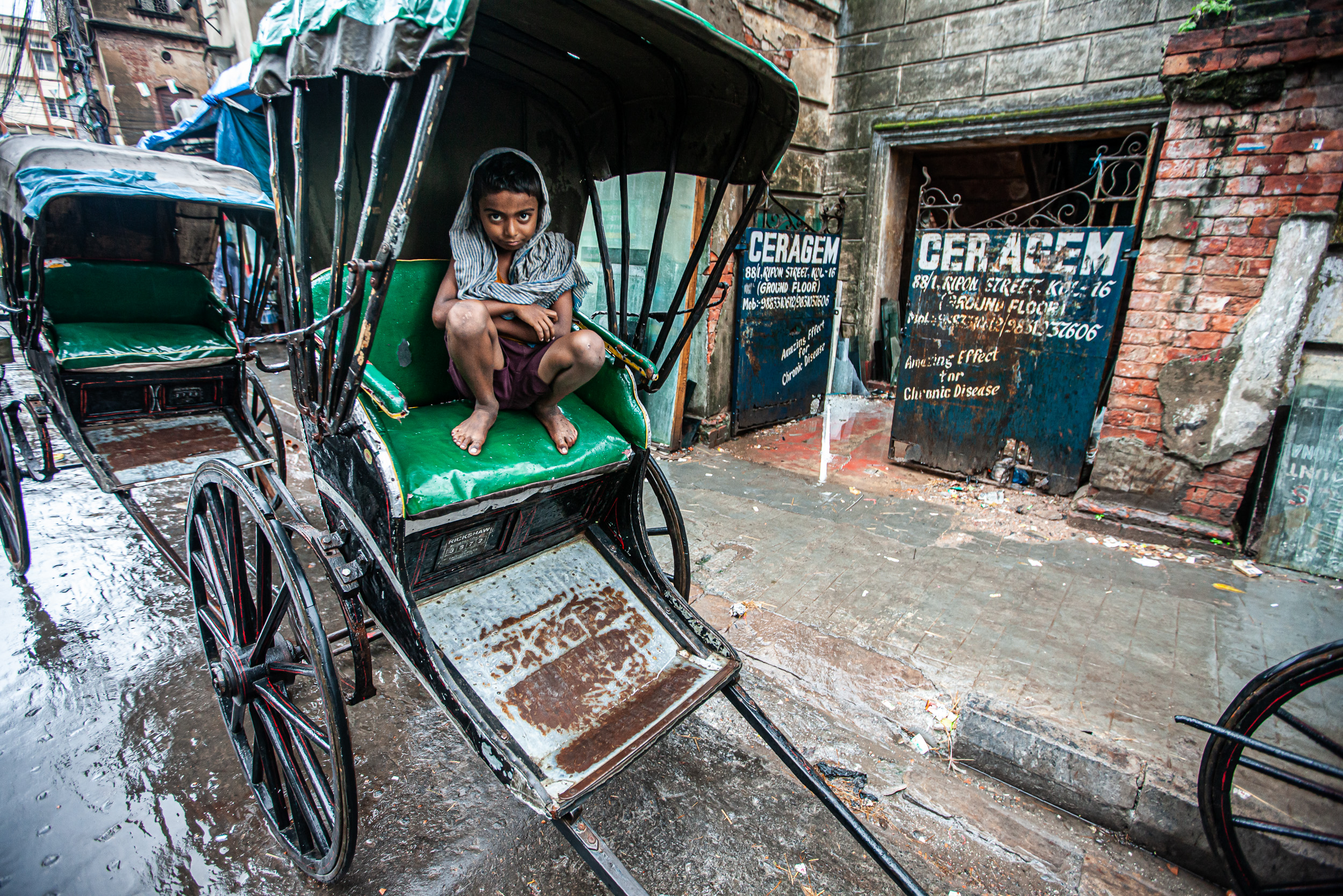 When not in use a rickshaw makes a handy restingplace.