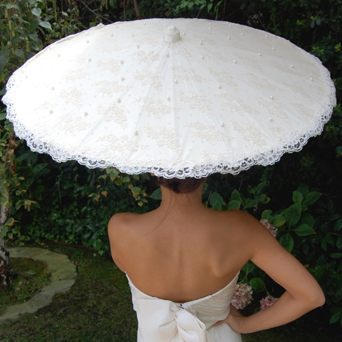 Pamela's Parasols uses the finest fabrics and laces (Alencon lace shown here is imported by the crafters who made the lace for Kate Middleton's wedding gown)  to create beautiful accessories for outdoor weddings and events.