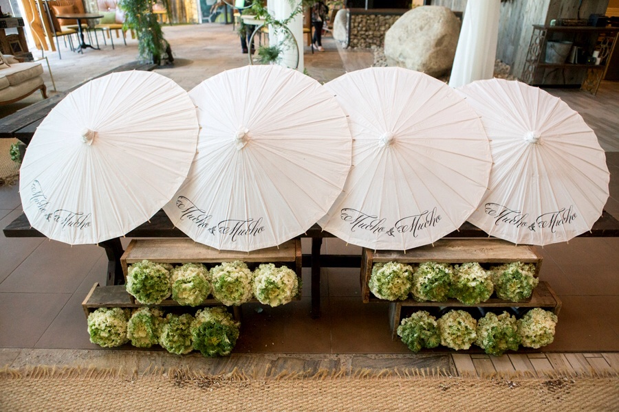 You'll love having your whole wedding pop with style with these custom parasols!