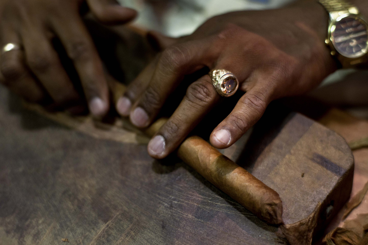 Unique and amazing specialty services like cigar rolling really add to your wedding's flavor!
