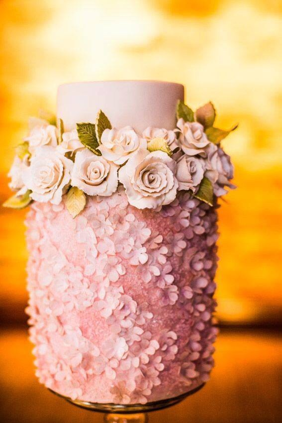 Love this pink cake with edible roses and sweet petals