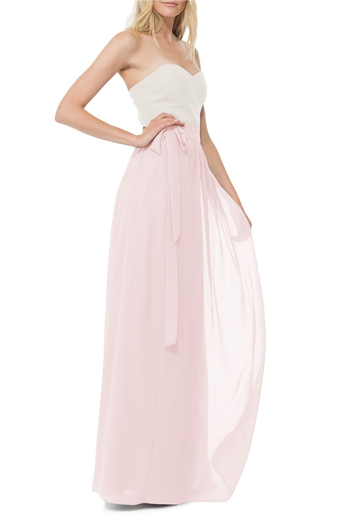 Designed for universal flattery, a sweeping chiffon skirt boats classic wrap styling with a defined waist by  Joanna August .