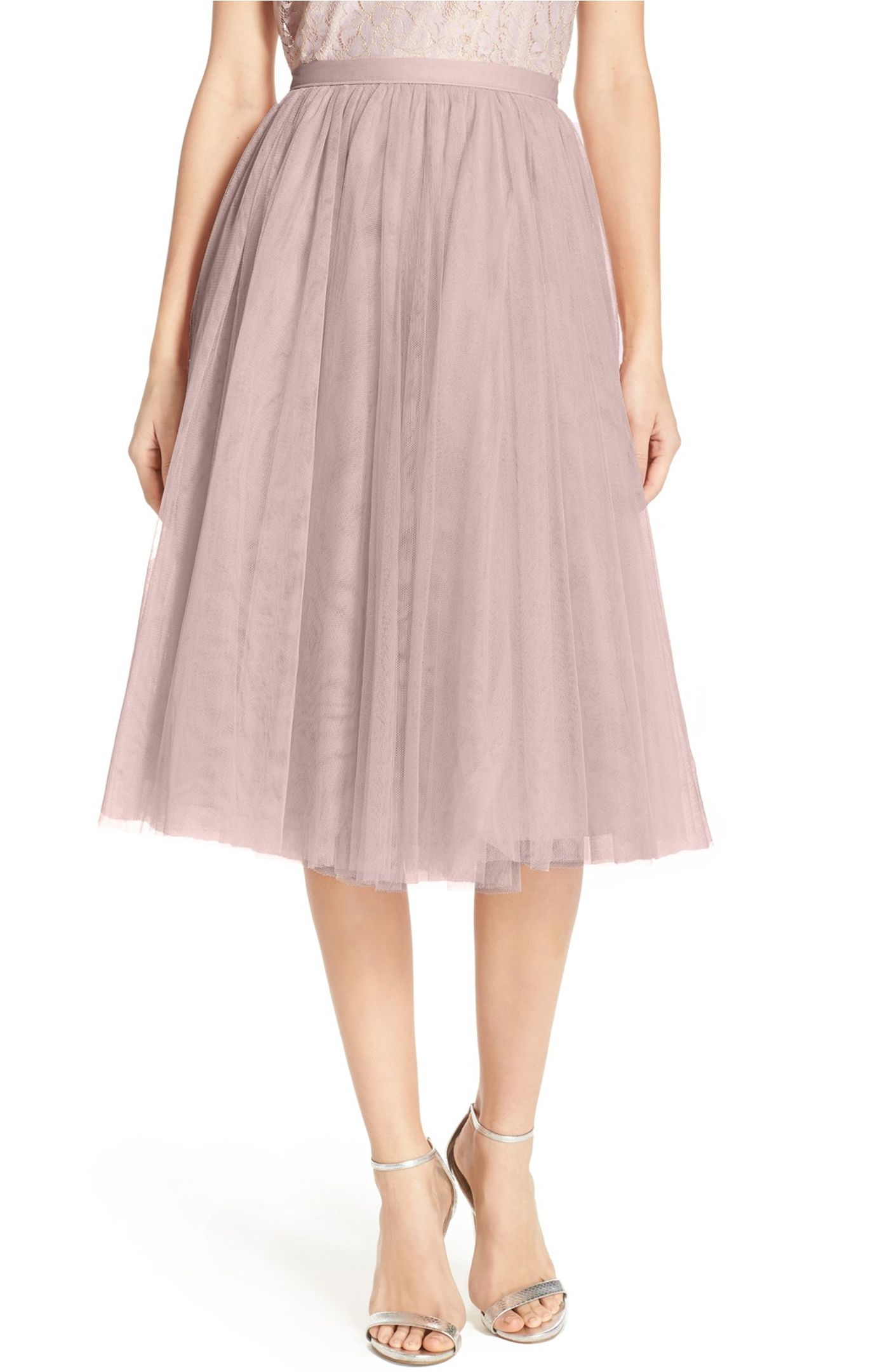 An A-line skirt offers delightful flounce sewn from layers of frothy tulle that drop from a fitted waist by  Jenny Yoo .