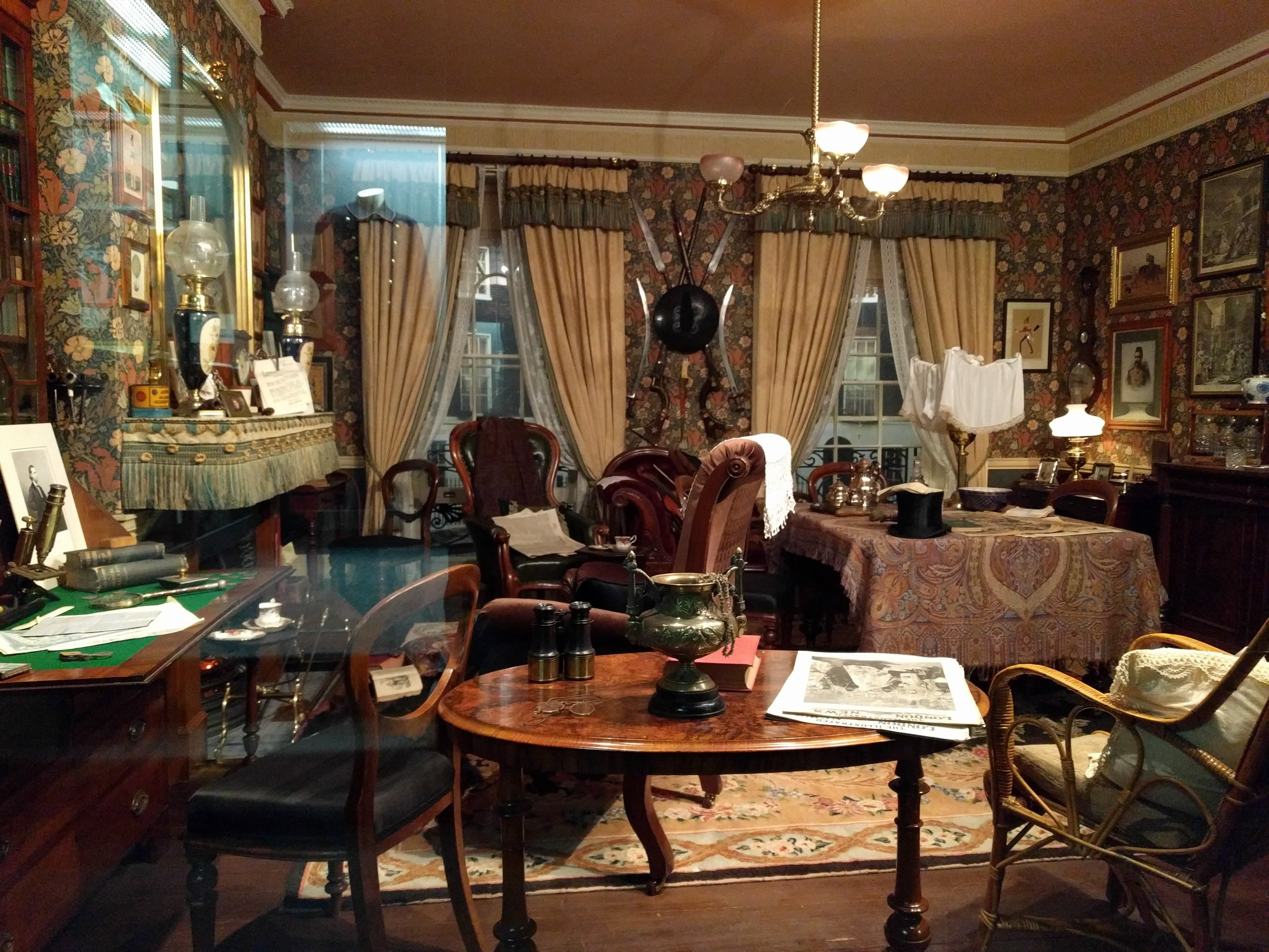 The audio guide says this is the only authentic re-creation of the living room at 221b Baker Street, because the designer used the books and illustrations to get accurate dimensions, designs, and furniture pieces where possible. And all the furniture is actual period pieces. This desk with the green top at the left is Watson's writing desk (Holmes's is in the opposite corner). Over the fireplace, you can see where Holmes has stuck his mail into the mantle with a knife; and on the wall between the windows are two jezail rifles, like the kind Watson got shot by in the Afghanistan war. You can't walk into the room, you have to sit outside a floor-to-ceiling window, but it was still cool. And there was a nice bench for my tired old Reichenbach-hiking legs.