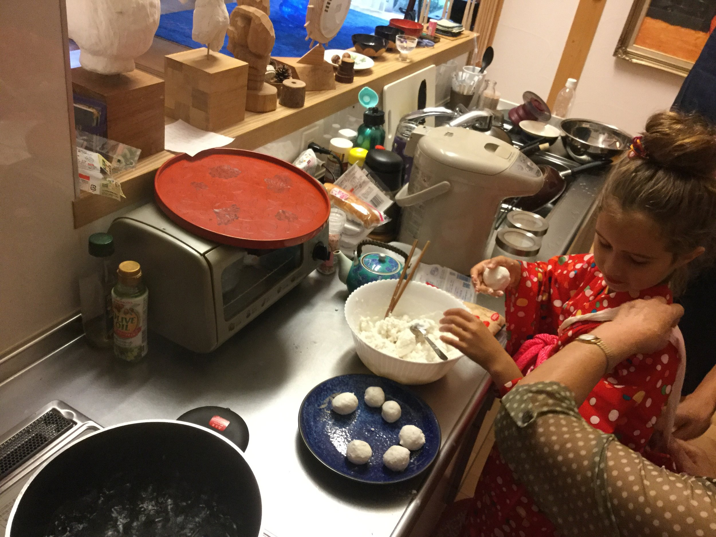 Then make little balls of the rice dough with your hands.