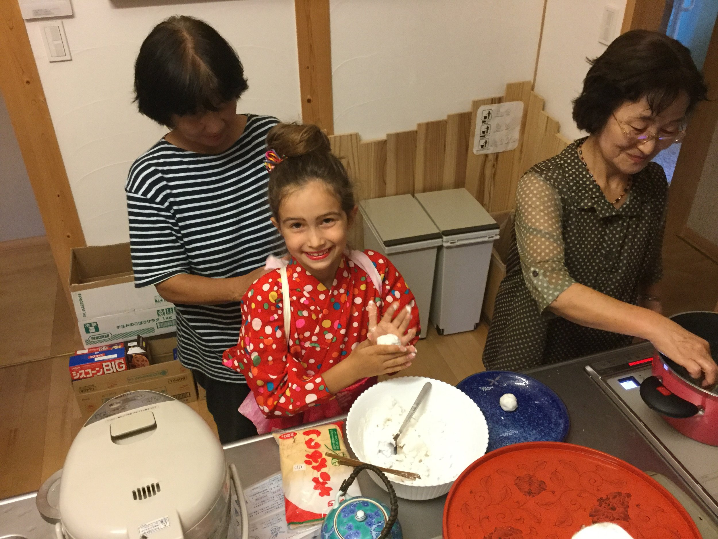 Have an assistant tie your kimono sleeves back so they don't get messy. Have other assistant start cooking dango balls by dumping them into boiling water.