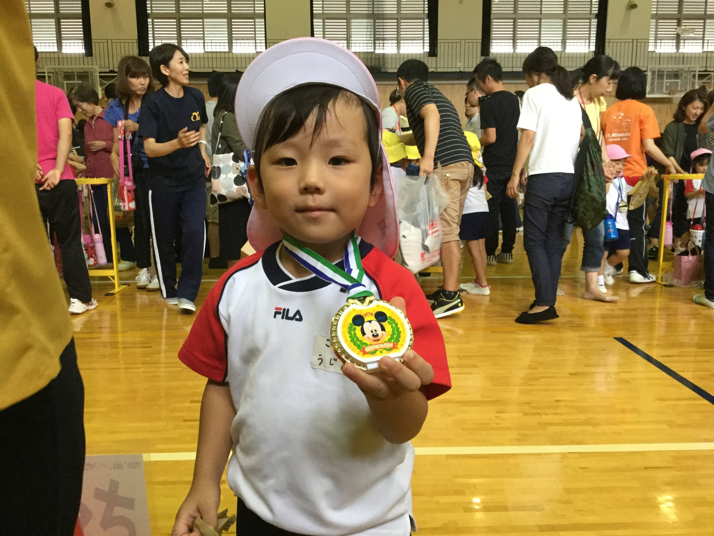 Aito proudly showing his medal.