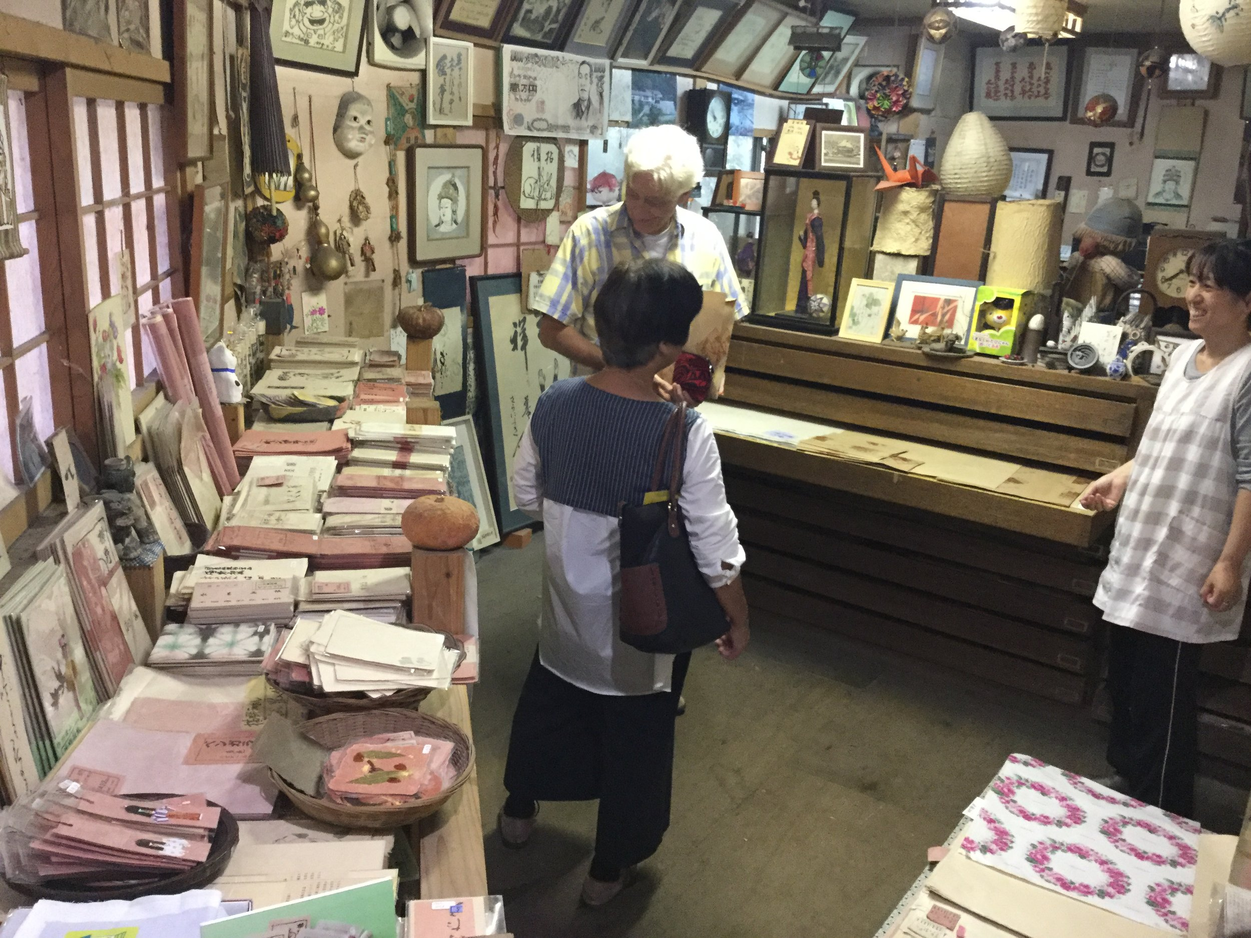 At the back of the workshop was the paper store. We really loved the papers and bought some little cards. We can't carry much but really wanted to support the artistry of their work.   We asked about the red tint - it is achieved by adding some red clay to the pulp.