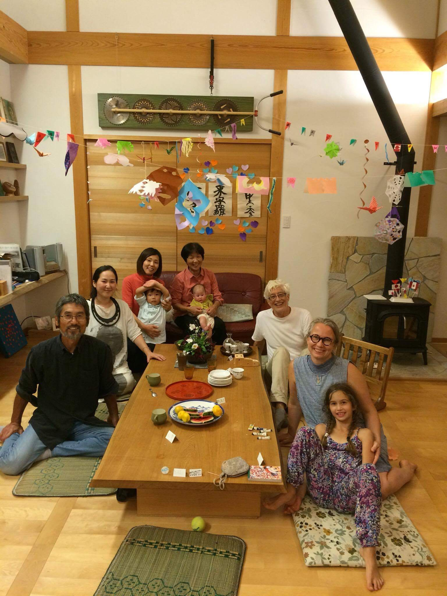 It was just a lovely party. Toshi, Yuka, Yoshiko and Aito and Taeka holding An. Naoki took the picture.   In front of Dante on the table the cool pencil holder Toshi made for us - if you look closely you can see the three parts representing the family.