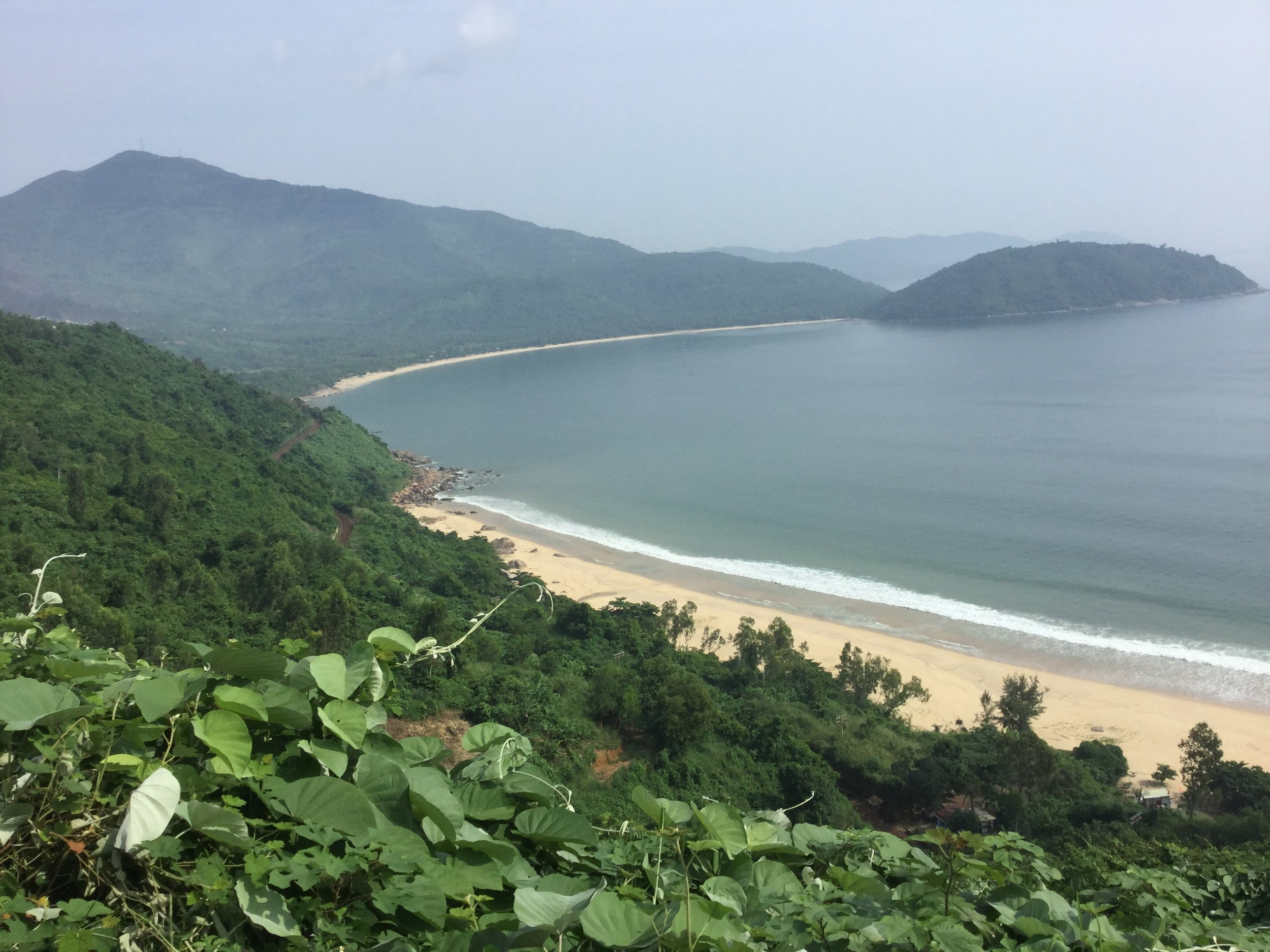 One of the sandy bays between Danang and Lang Co. If you look carefully you can see the railway - a single track meandering a little bit up from the beach. It goes all the way to Hanoi.