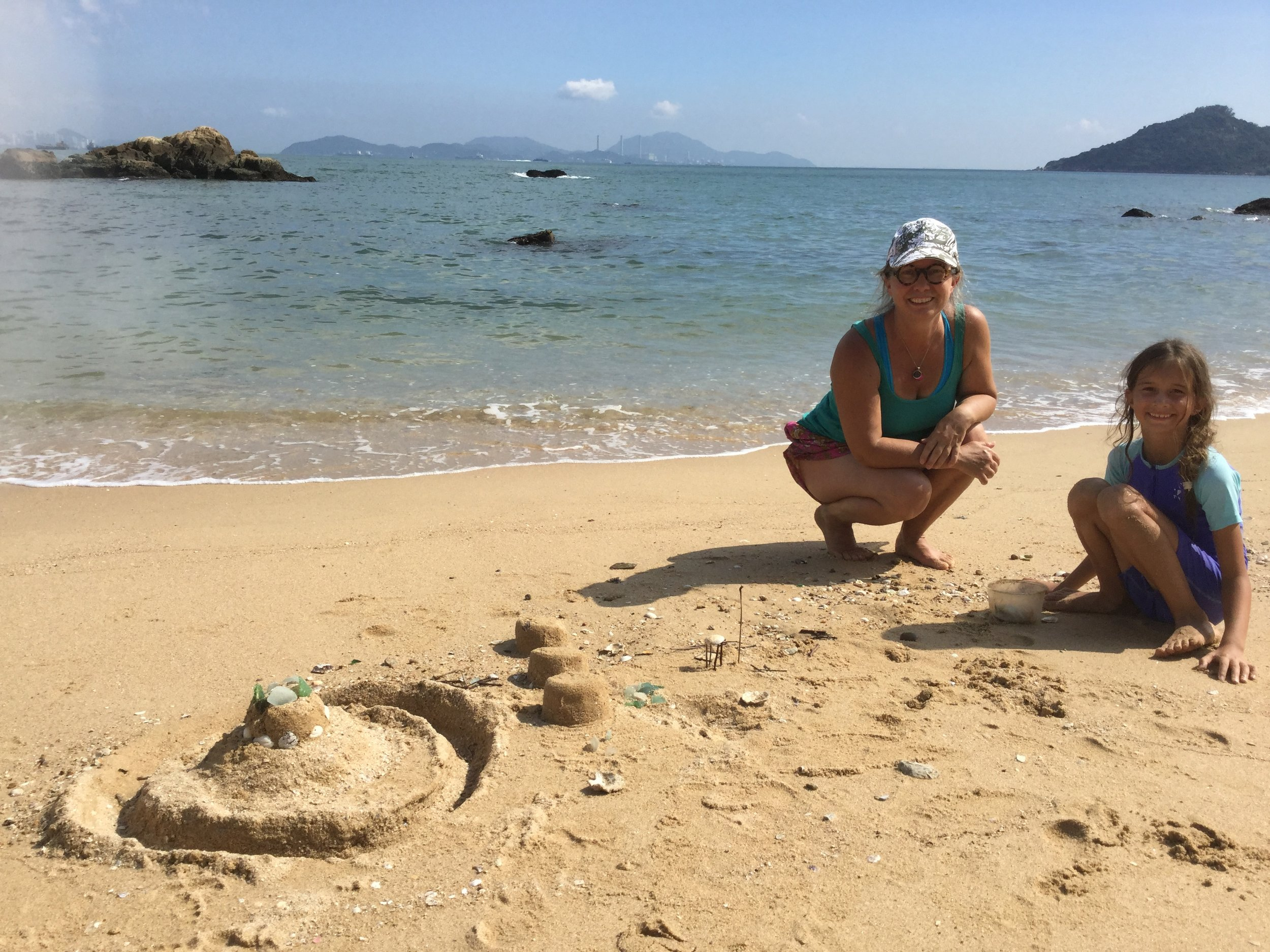 Seashells, glass bits, sticks and sand castles.
