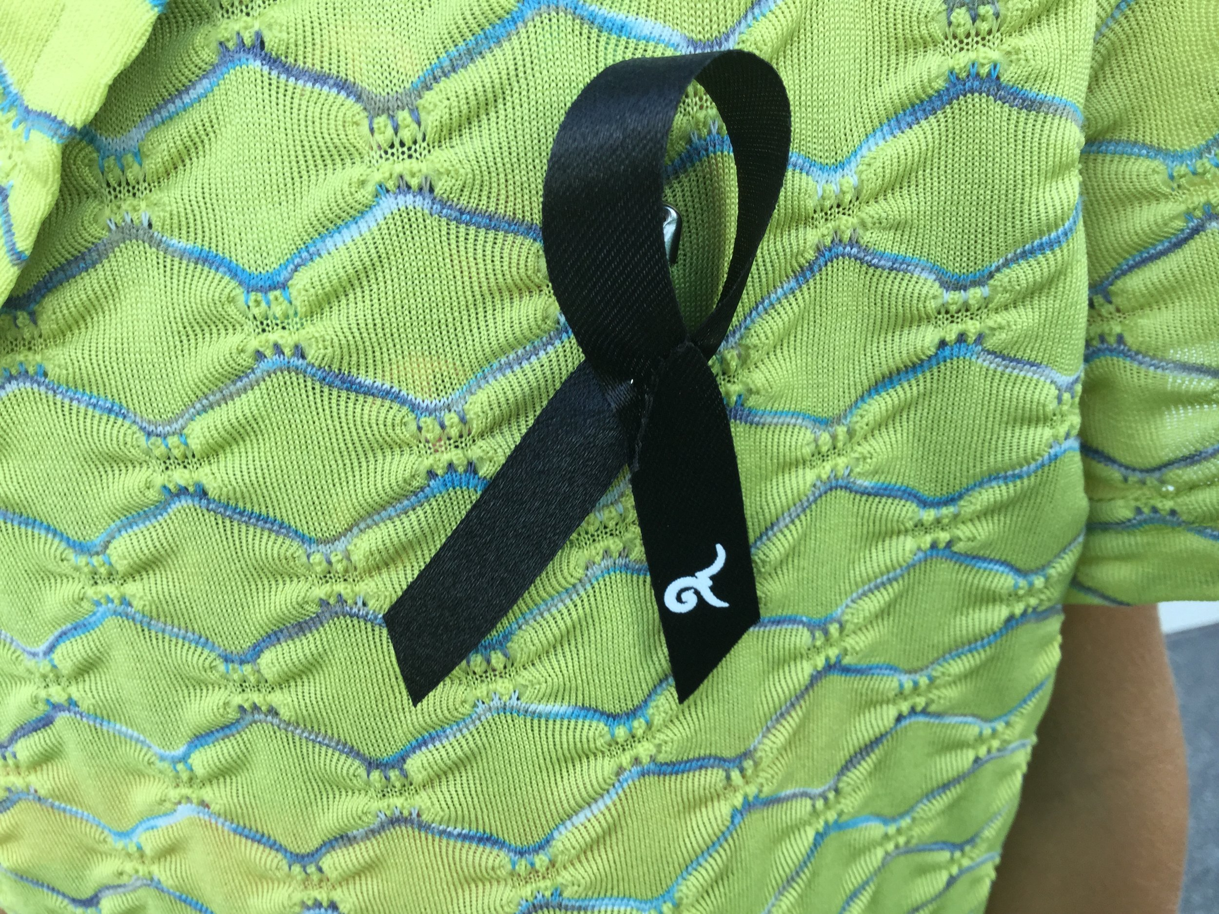 Lili wearing her lapel ribbon.