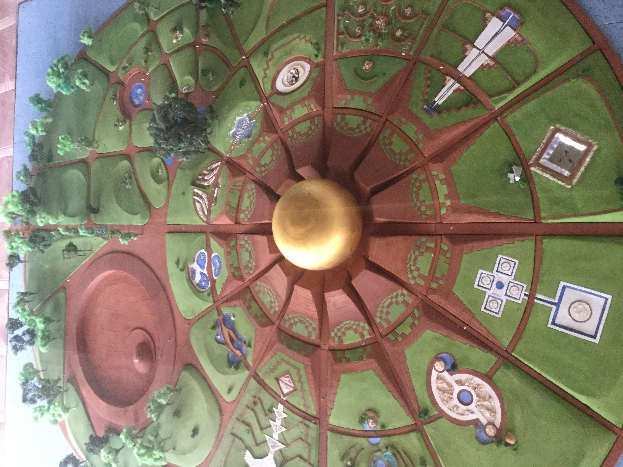 This model is at Auroville Town Hall. It shows all the twelve gardens - three have been built so far.