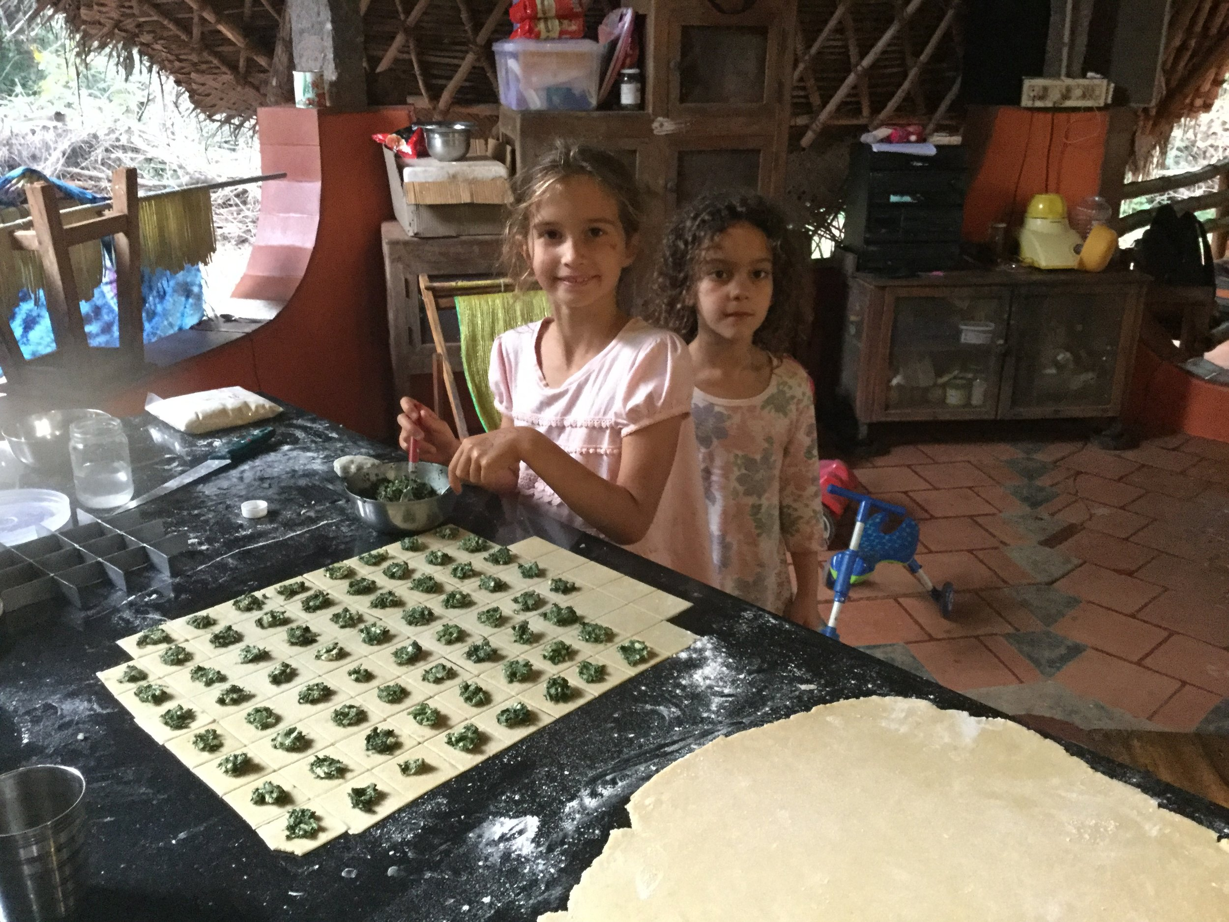 The children got to help with filling the ravioli - spinach, onion and feta mix prepared by Tamar. Marilena is a visitor from Greece, and was helping Lili.
