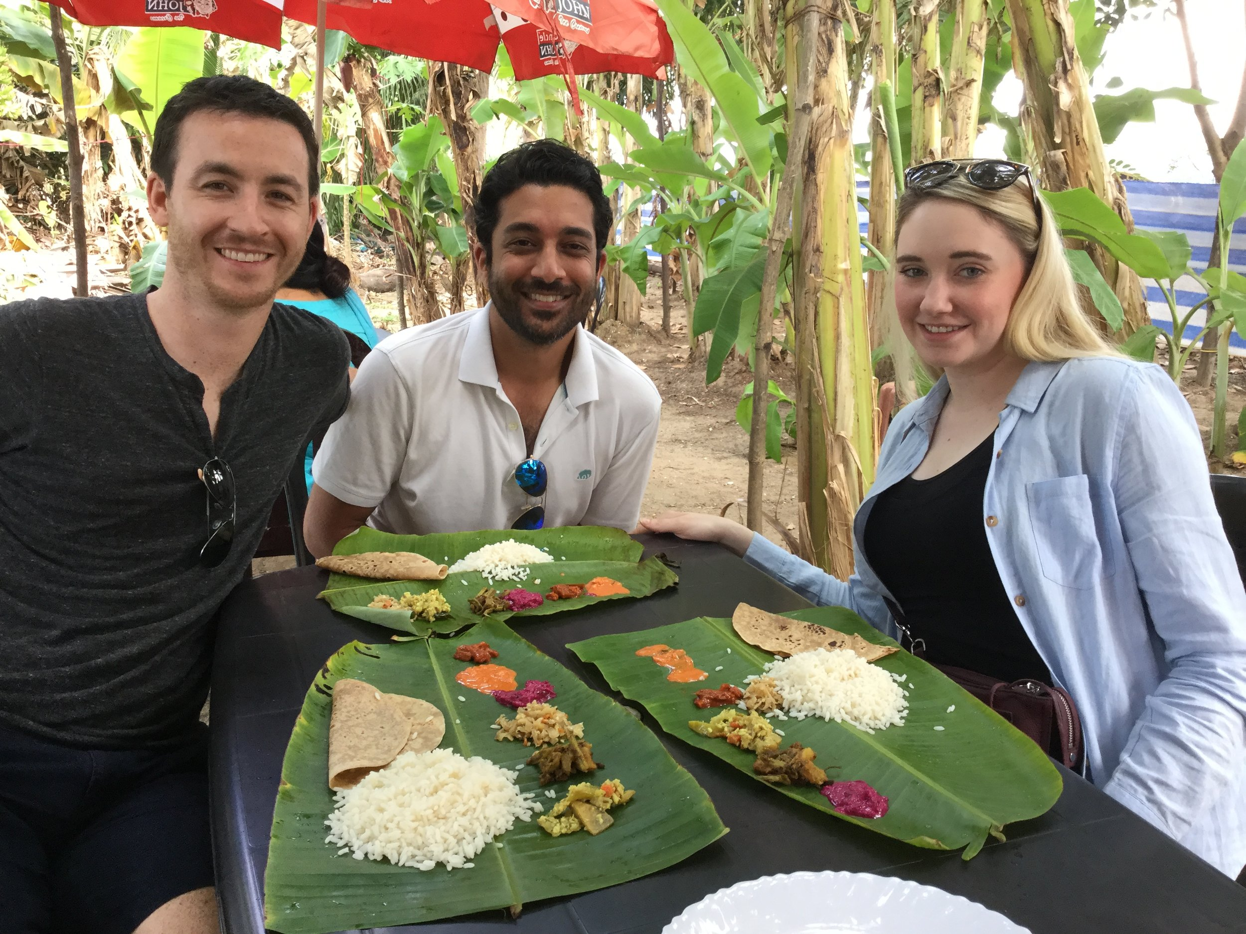 Enjoying veggie thali for lunch in true South Indian way - off banana leaves.