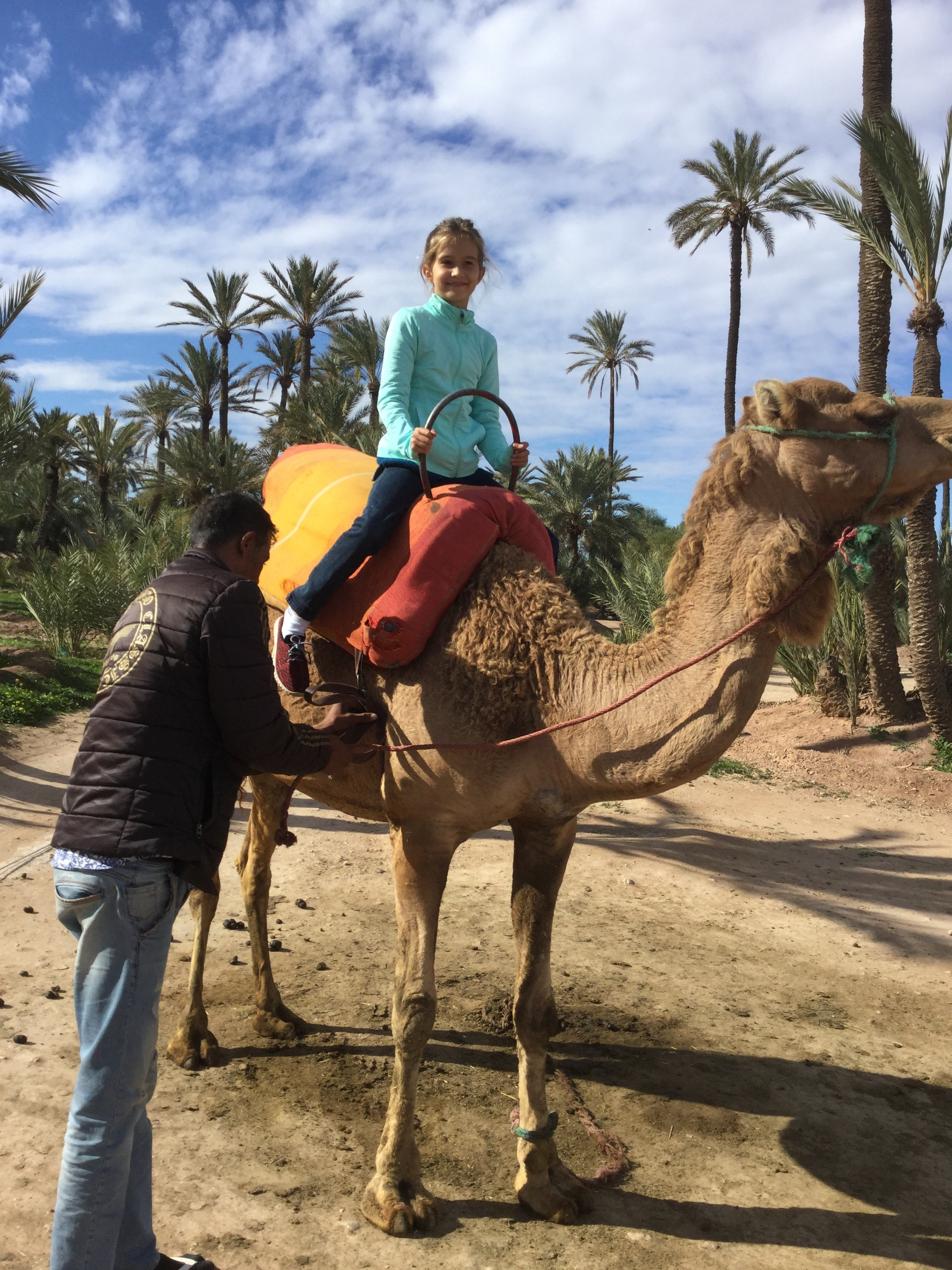 Lili getting on the camel. No fear at all - and they are high!