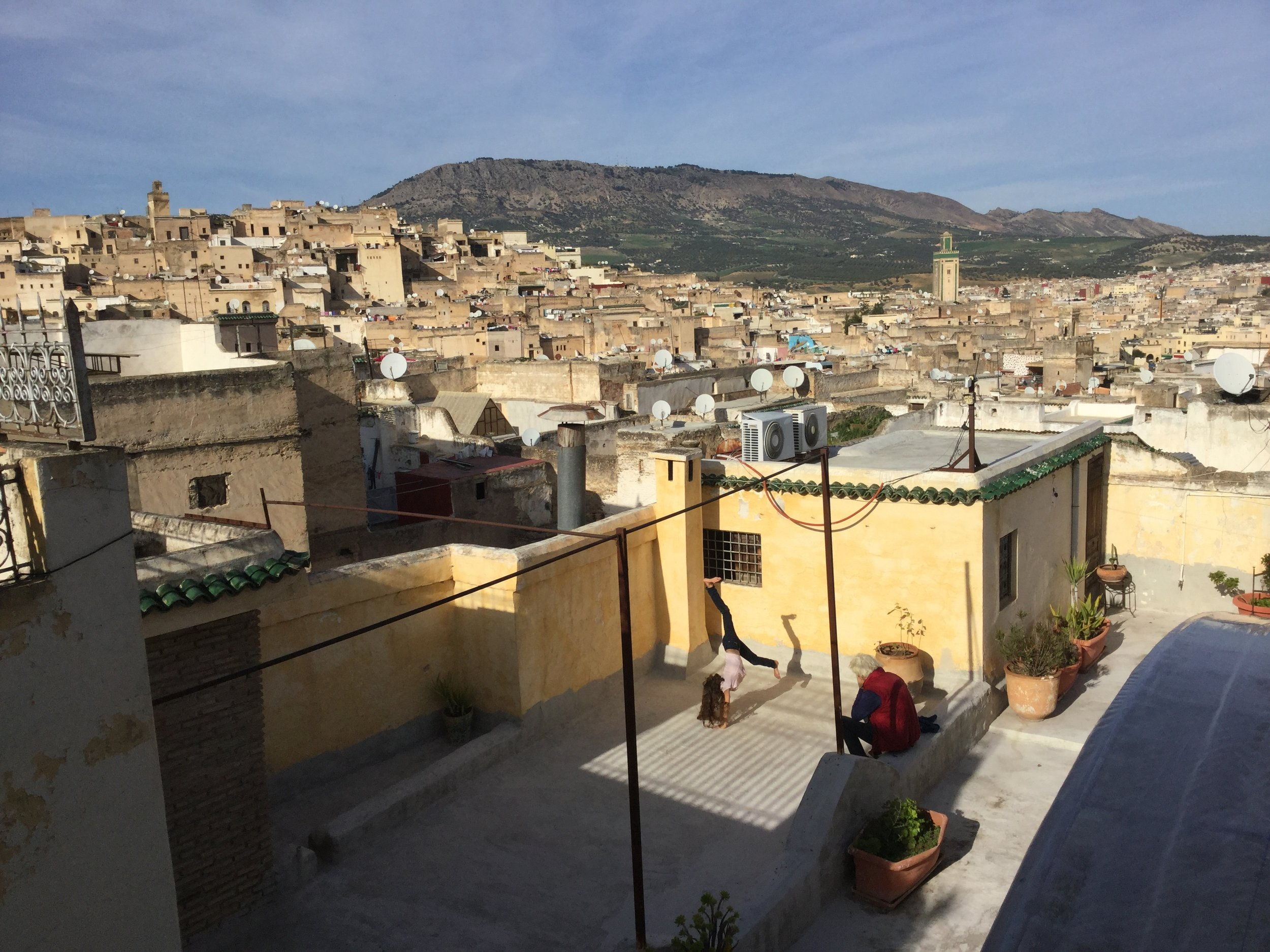 View from the roof patio of our riad. True to style, Lili is practicing her cartwheels.